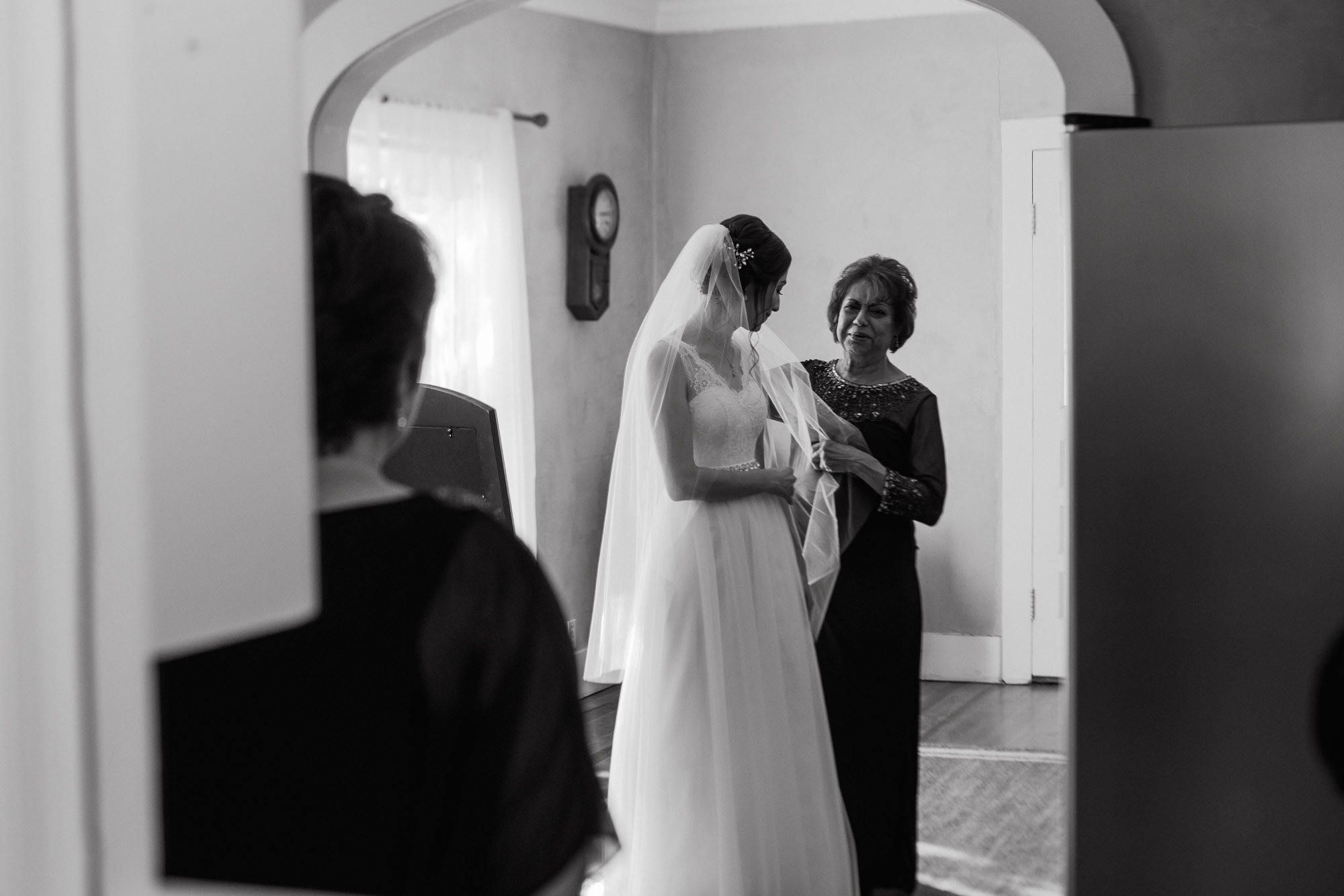 bride and her mom getting ready in black and white