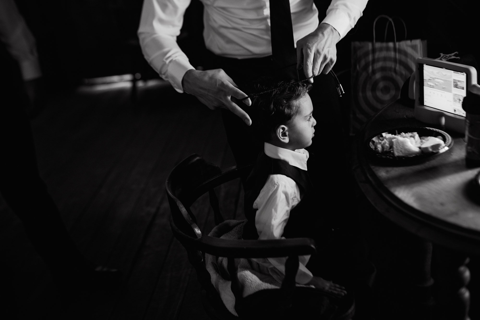 black and white ring bearer with a bolo tie