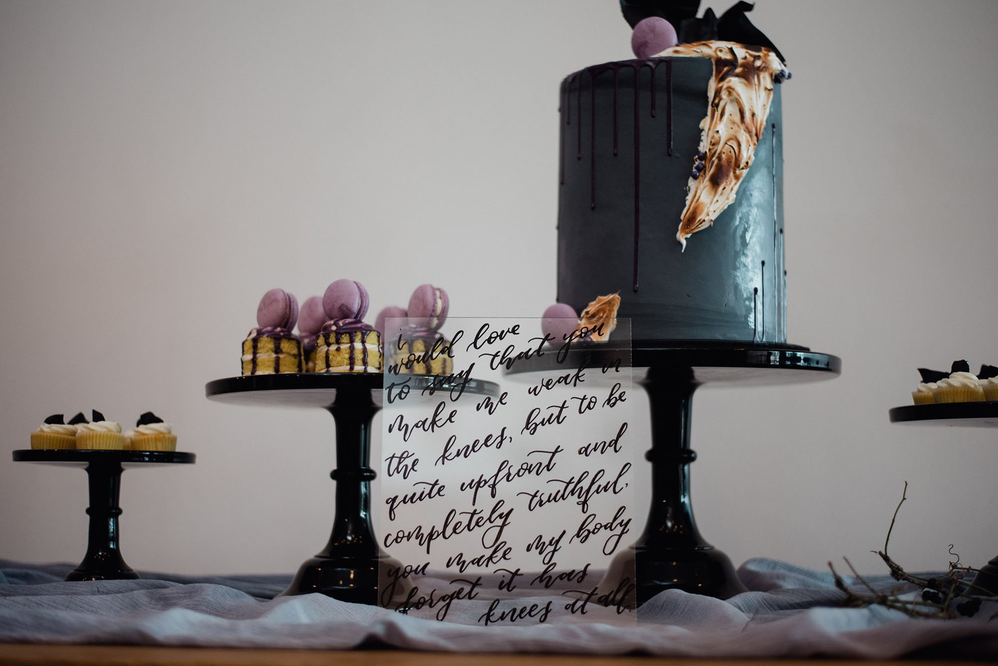 melody's joy cakes at an indoor wedding in austin, wedding photography at the peached social house, wedding cake details