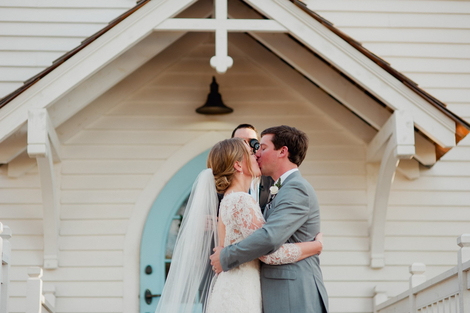 bride and groom kiss at their round top texas wedding outdoors in texas
