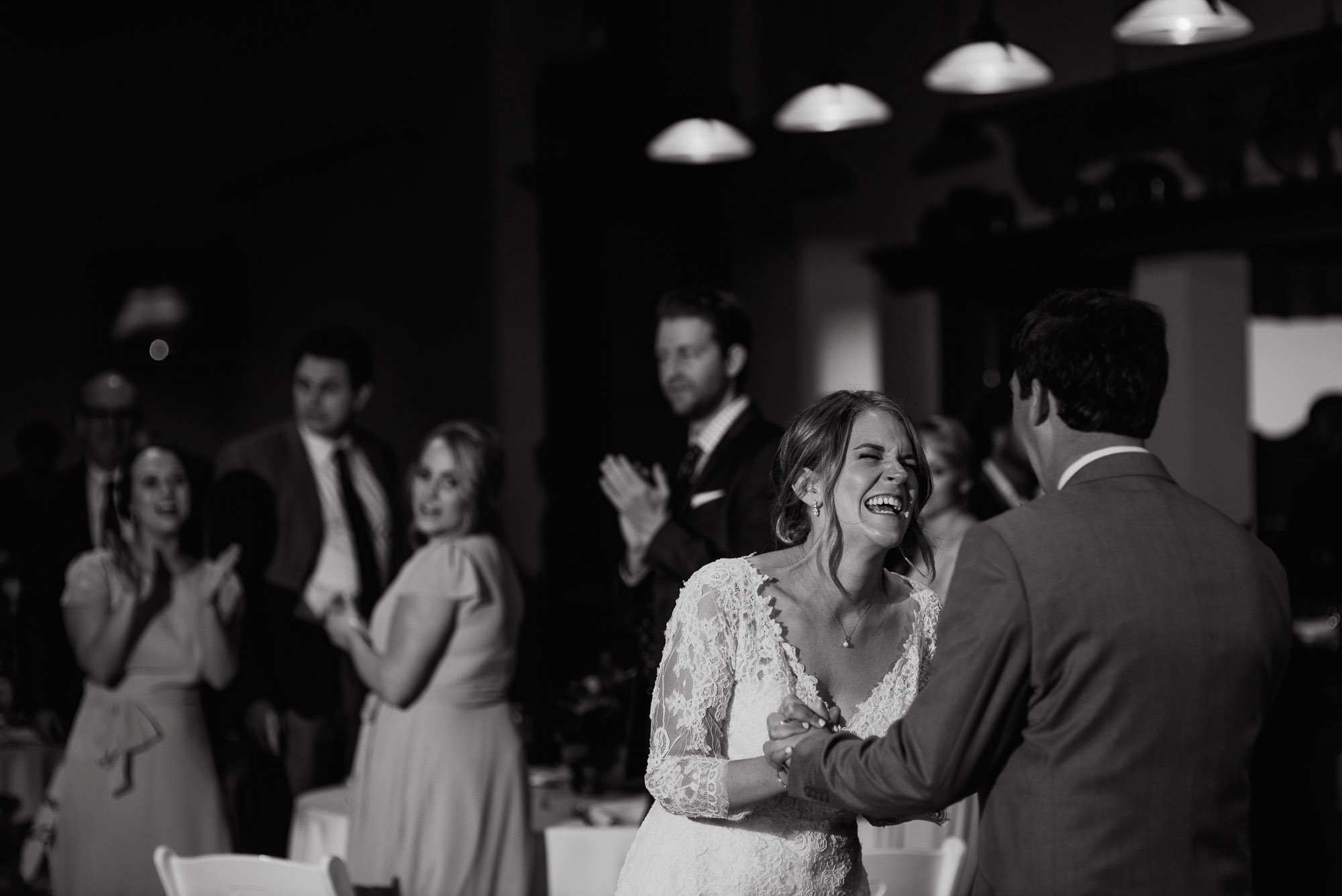 black and white bride laughing at her husband during her first dance, austin wedding photographer