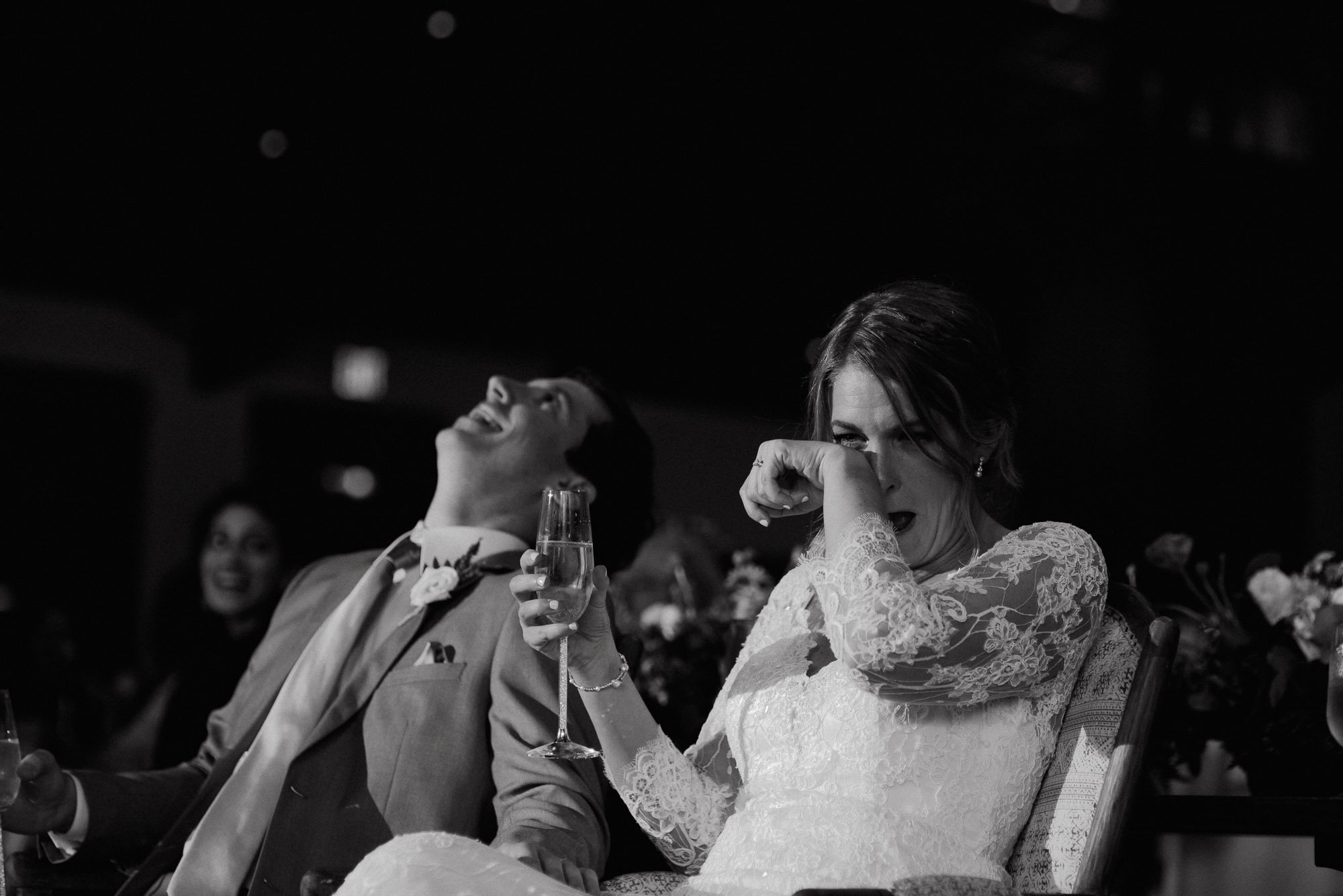 bride and groom laughing while crying during their wedding toasts at henkel hall in round top texas