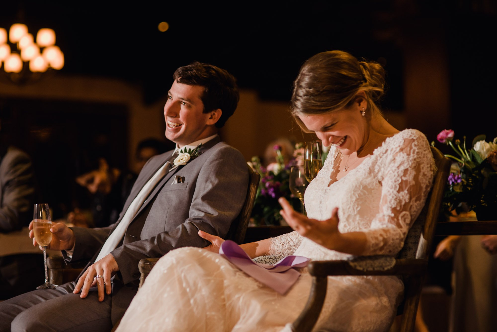 bride laughing during her wedding toasts