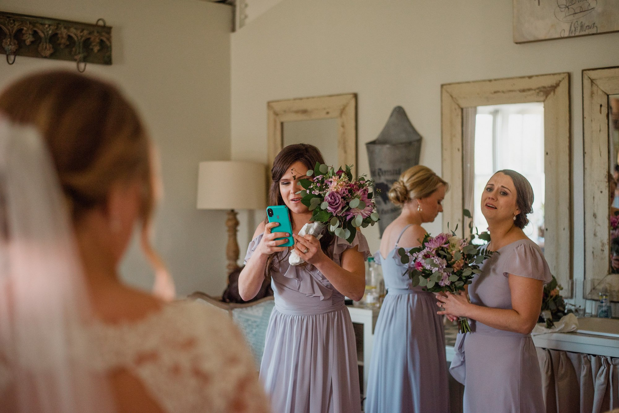 bridesmaids react to seeing bride in her dress for the first time, bridesmaids reactions, bridesmaids first look, bridesmaids in the bridal suite at henkel hall