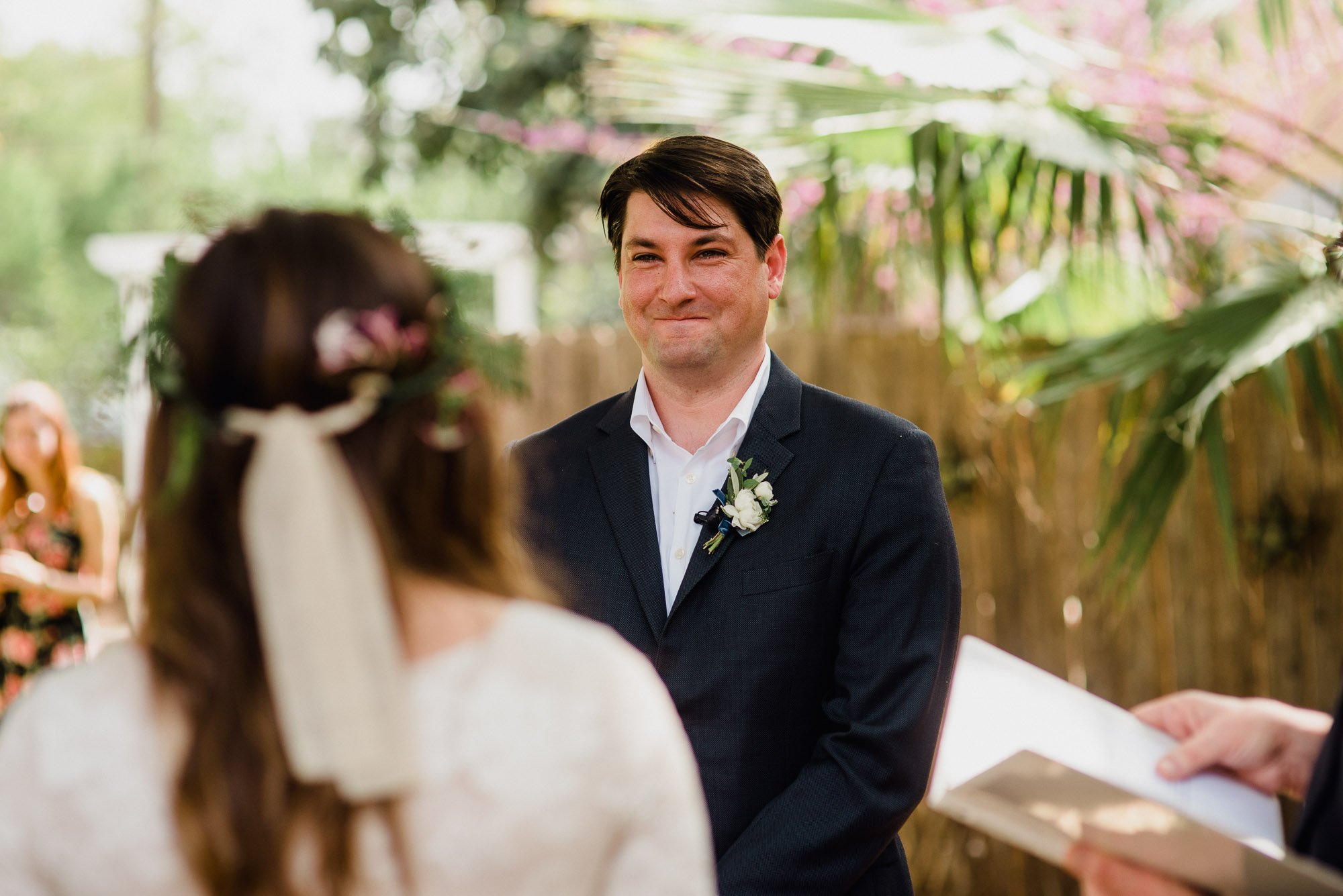 groom smiling at his bride at a backyard wedding in san antonio at king william manor