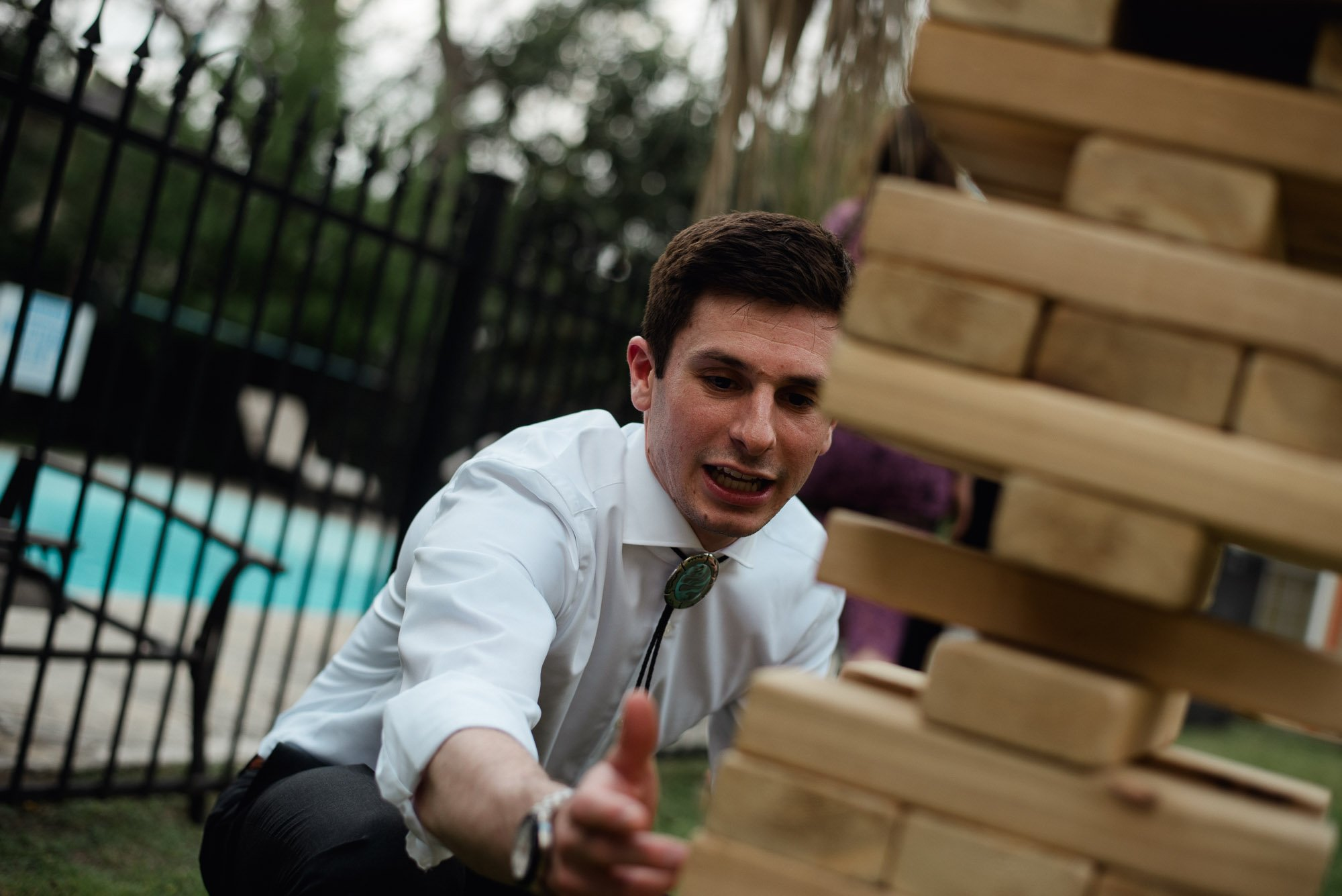 san antonio wedding photographer, backyard games at a san antonio wedding, giant jenga at a wedding in san antonio