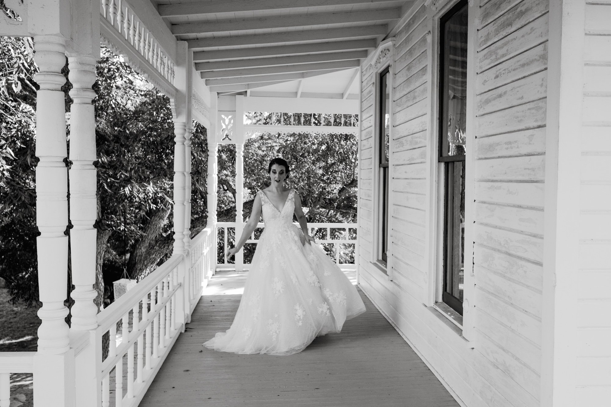 fun and goofy bridal portraits at the barr mansion in austin