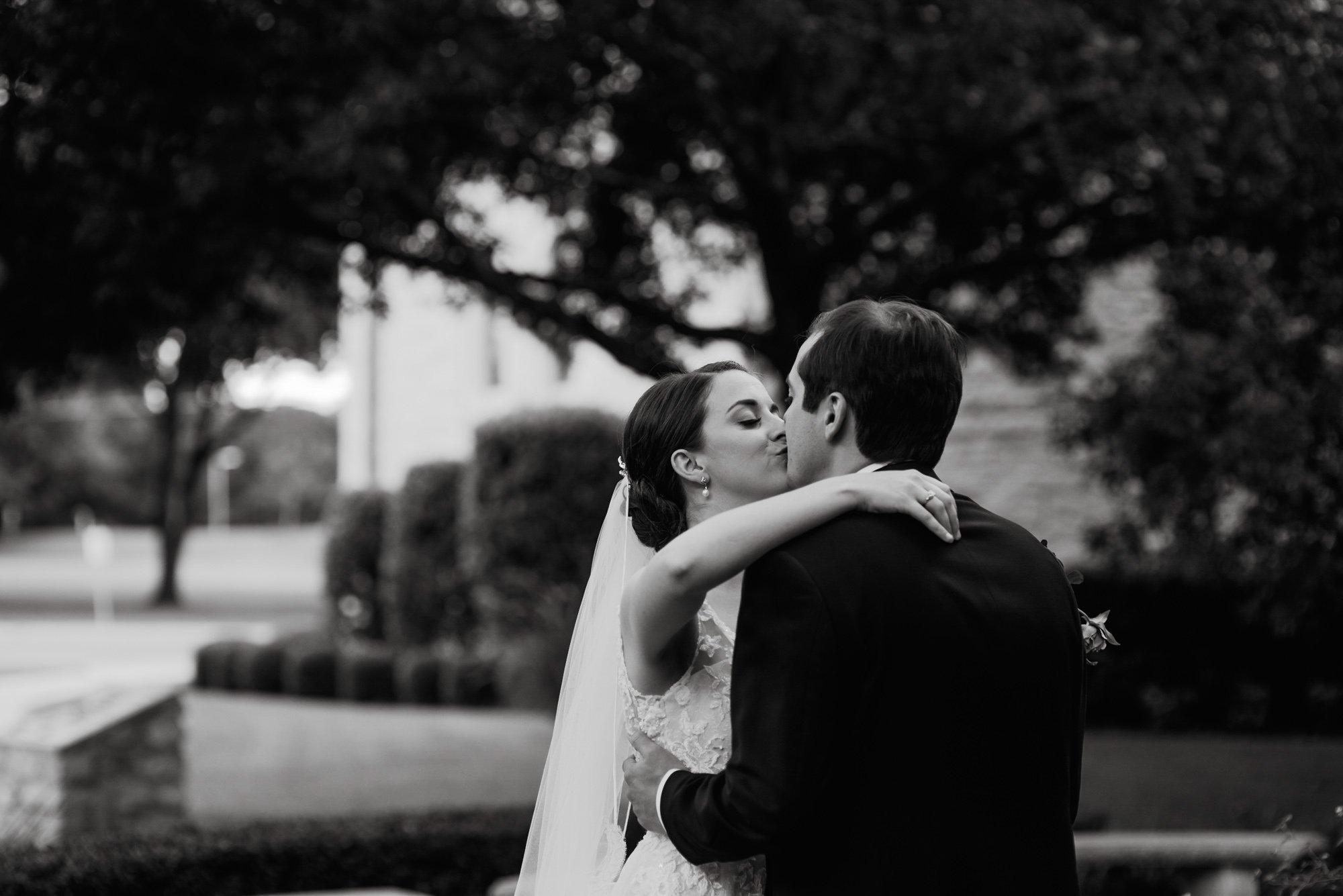 kiss shared by bride and groom after their first look at st. louis king of france