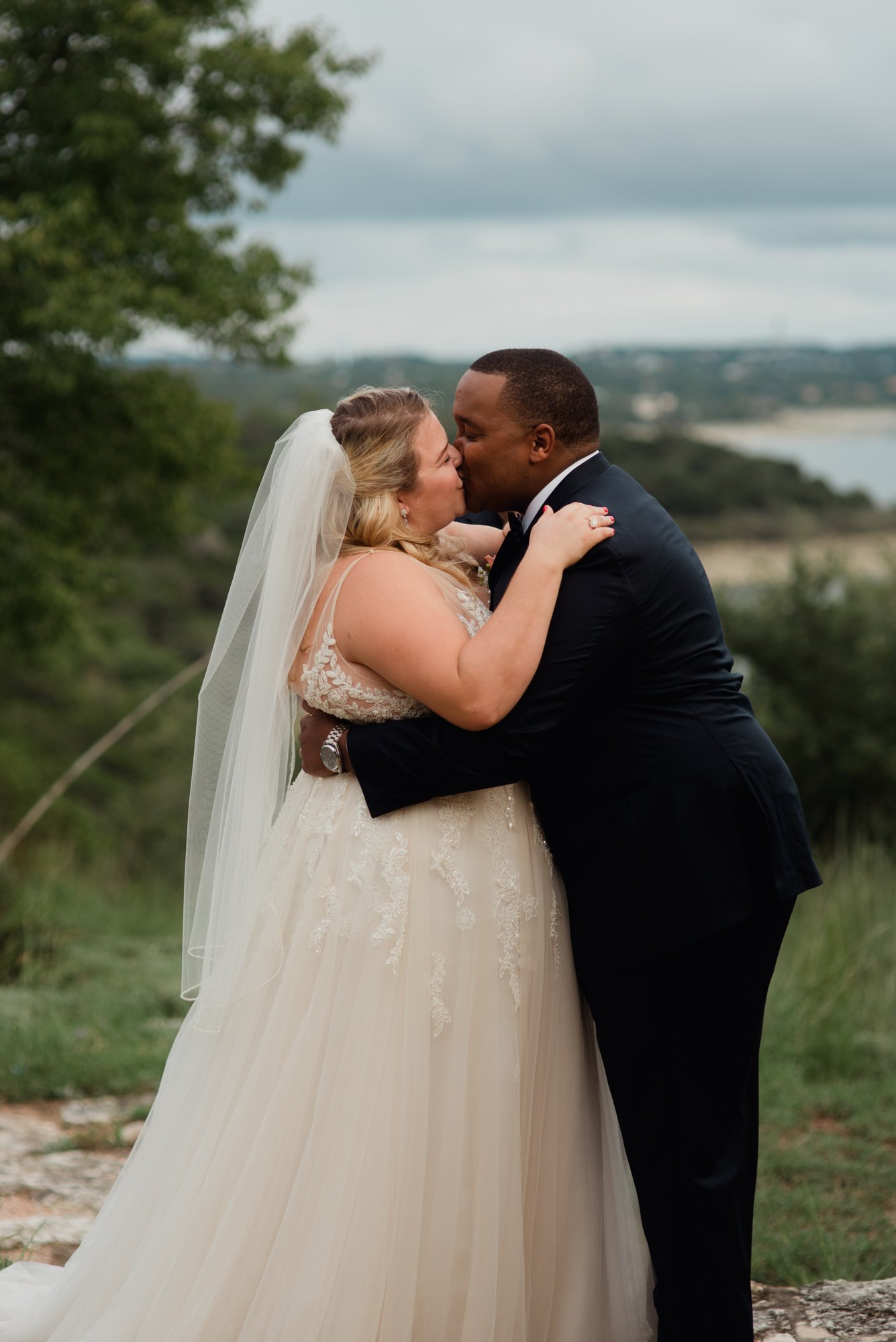 first kiss photos, outdoor wedding overlooking lake travis,