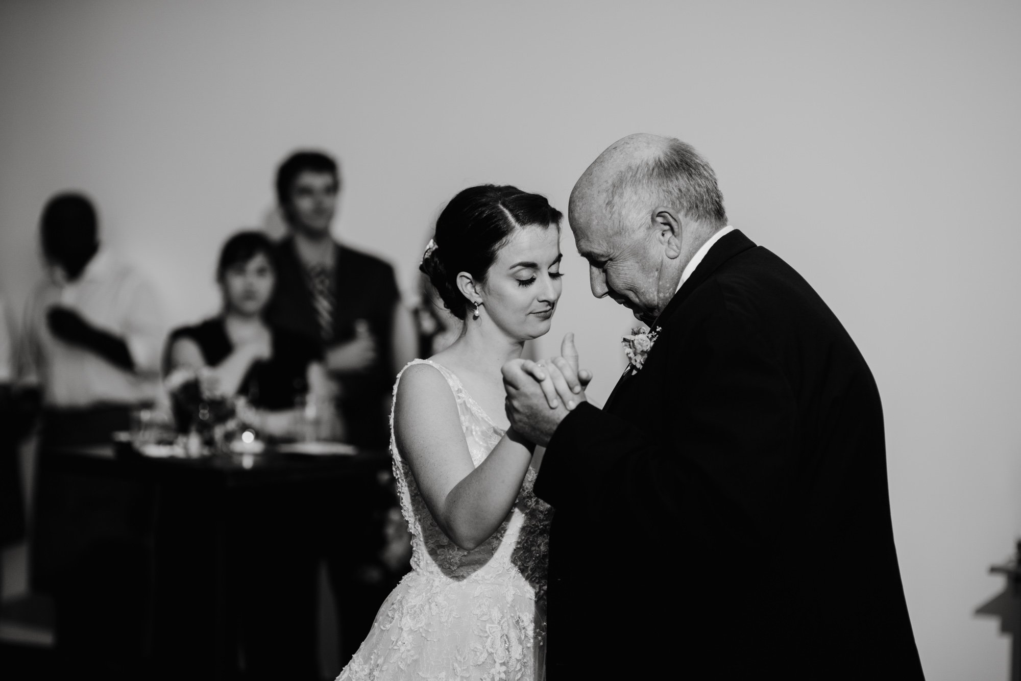 father daughter dance photographs, black and white photos of father and daughter dancing at a wedding, modern wedding photography in austin texas