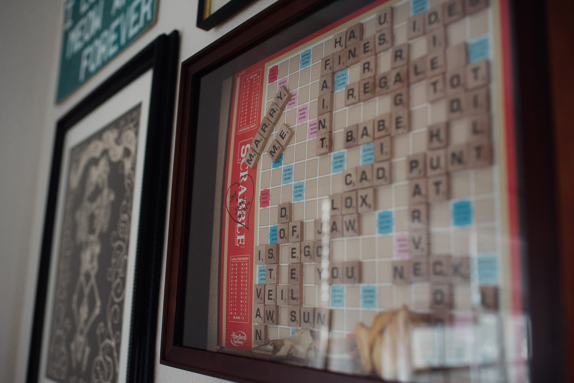 proposal question on a scrabble board, engagement session details, at home engagement session details