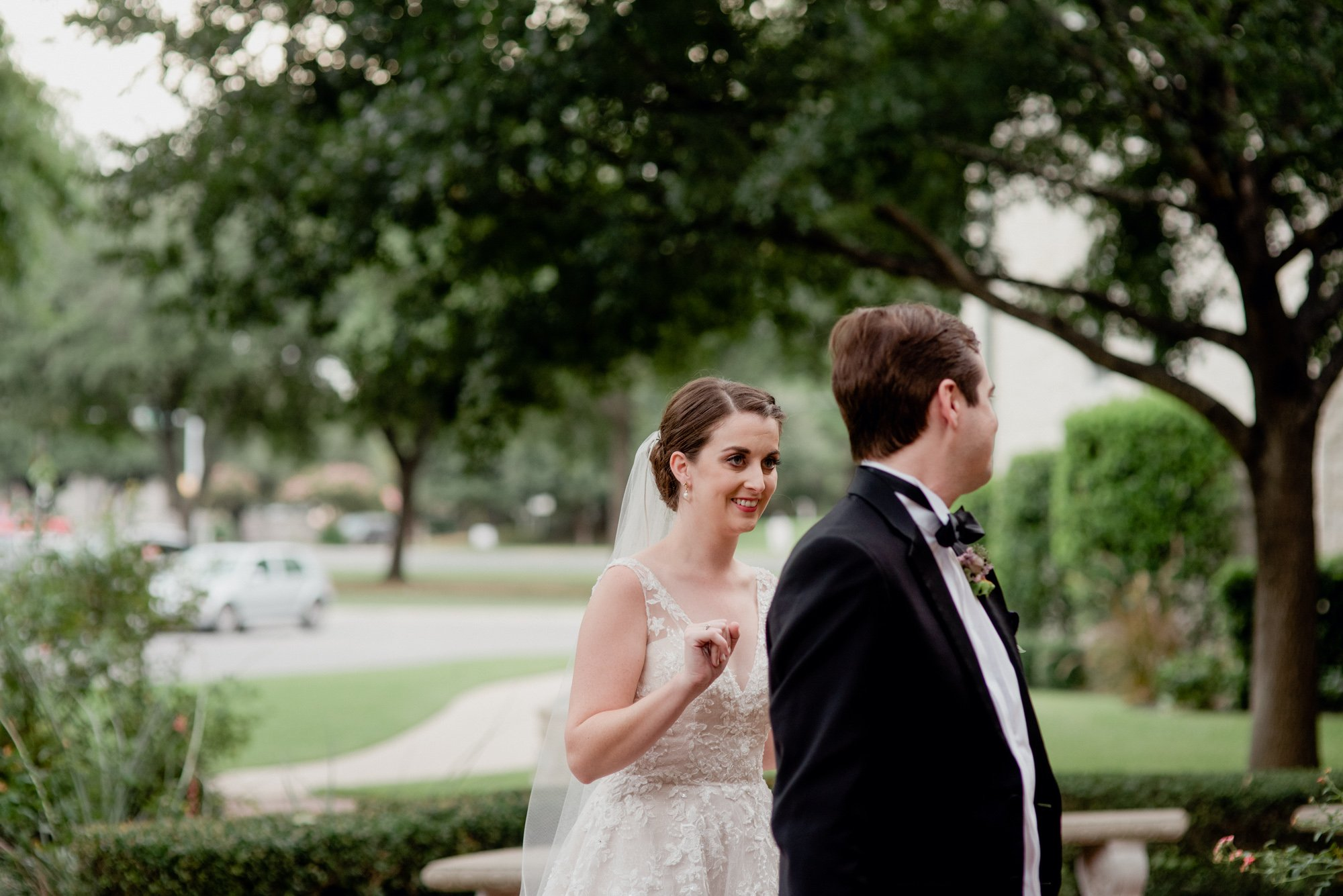first look outside catholic church in austin, fist look at a wedding, emotional wedding photography in austin texas