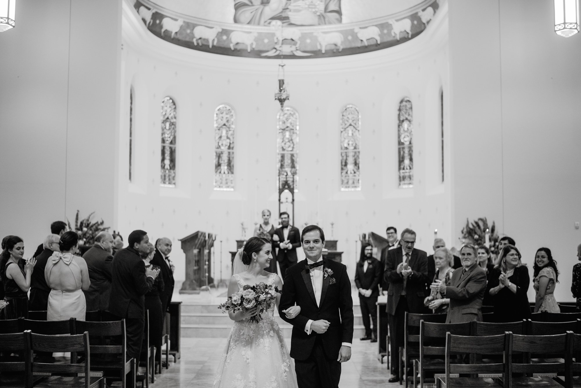 black and white wedding photos at st. louis king of france catholic church in austin