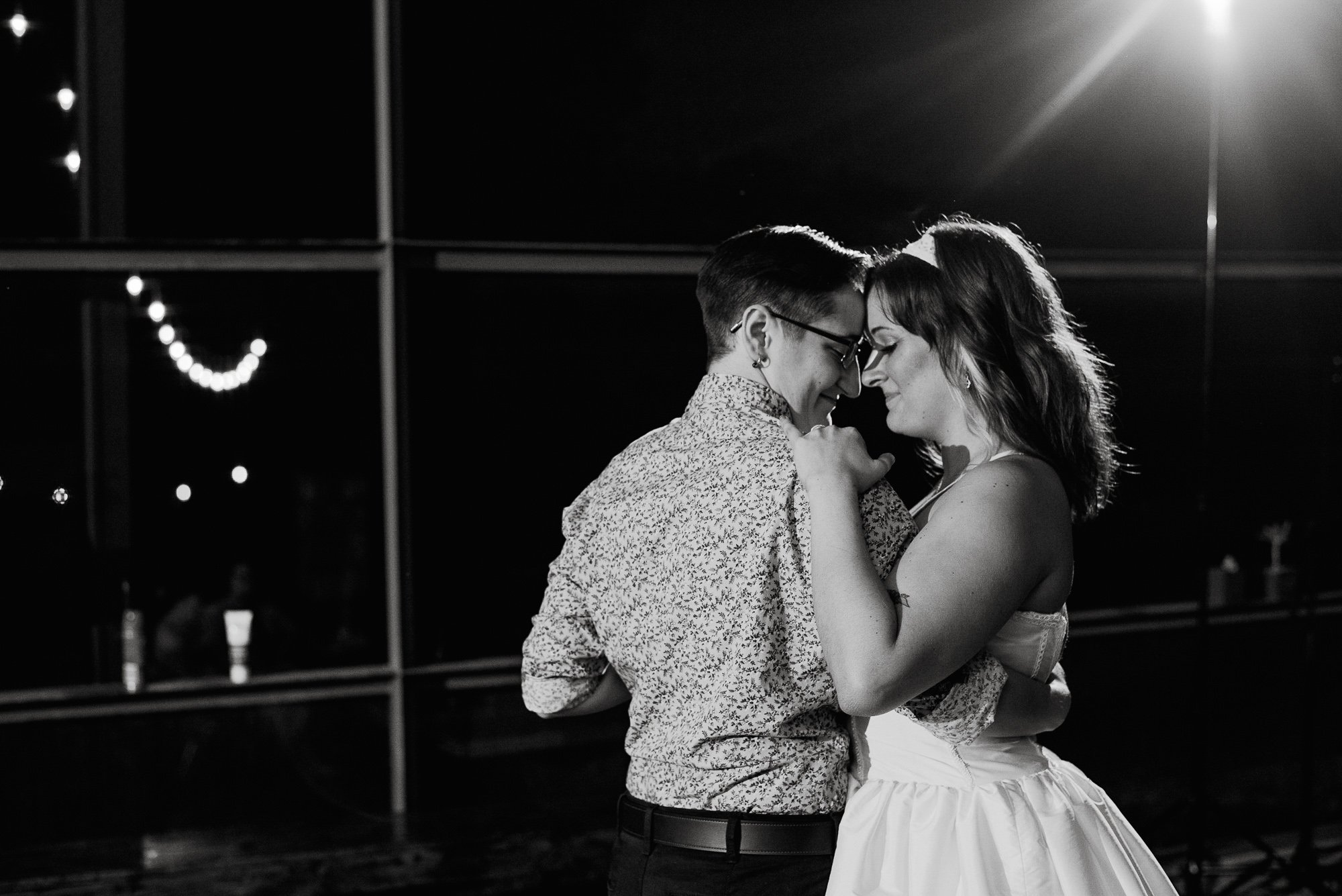 first dance on the porch at the plant at kyle wedding venue in austin texas,