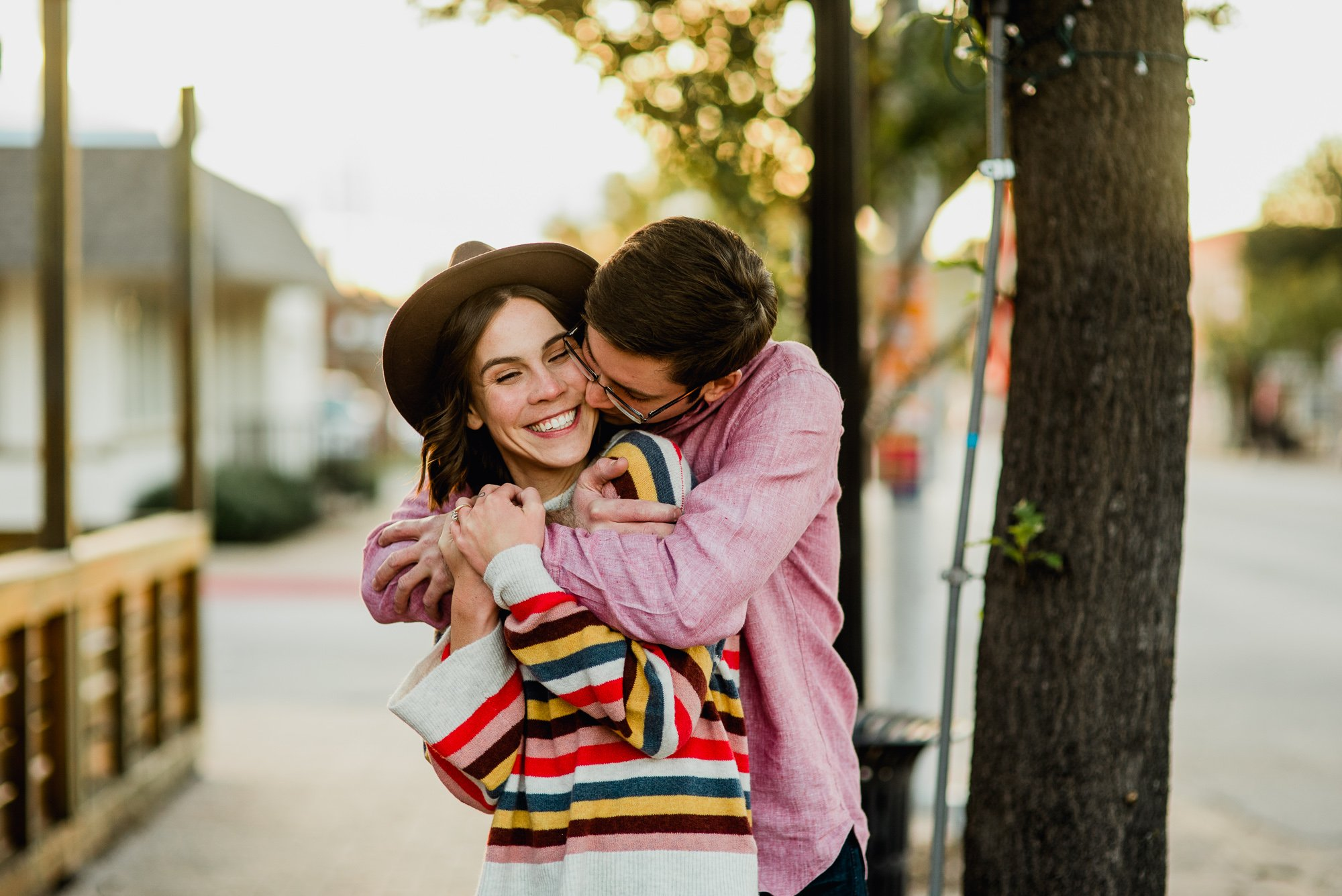 lindsey and jordan snuggle up during their fall engagement photos on magnolia avenue in fort worth texas