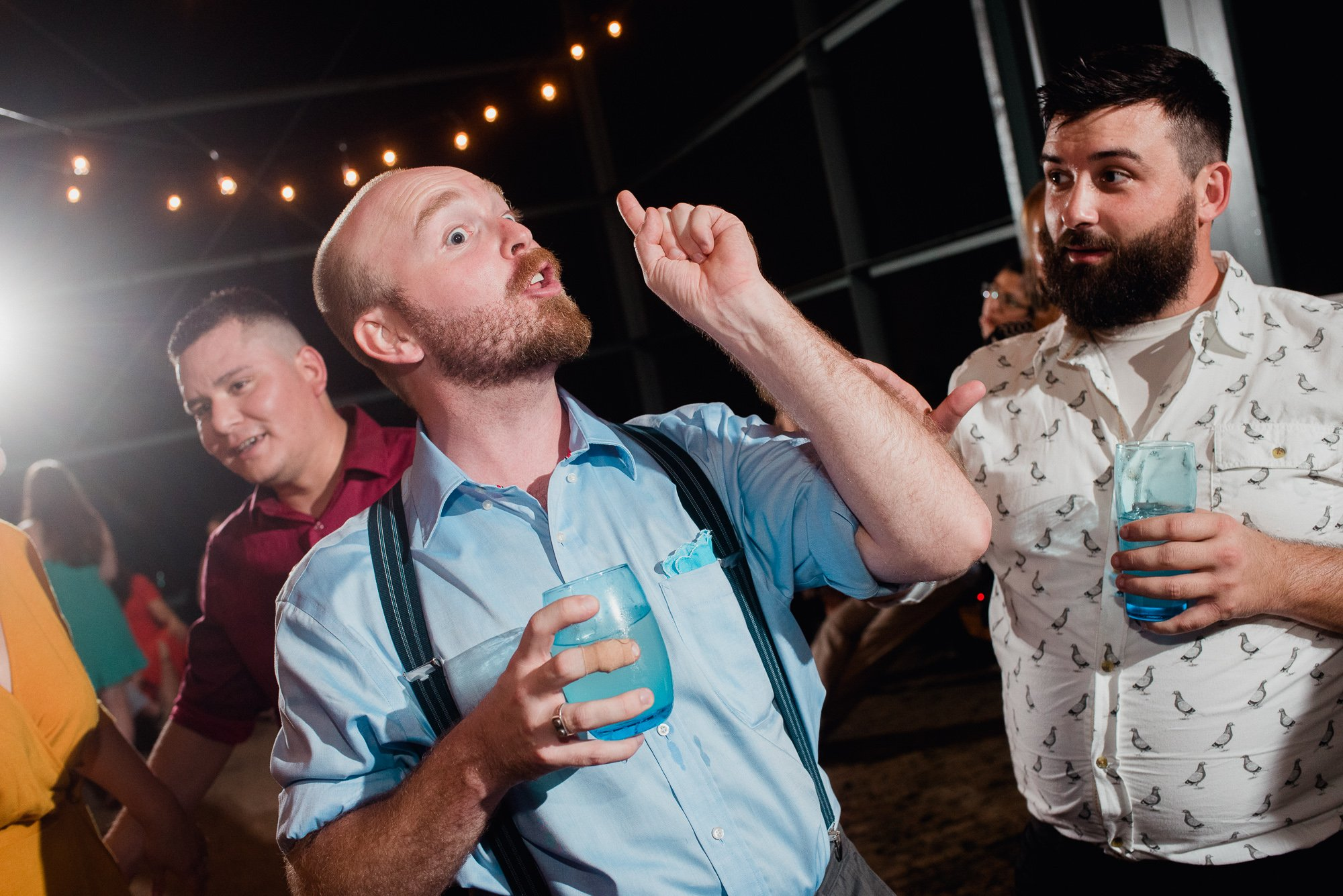 guests singing and dancing at a backyard wedding in austin texas
