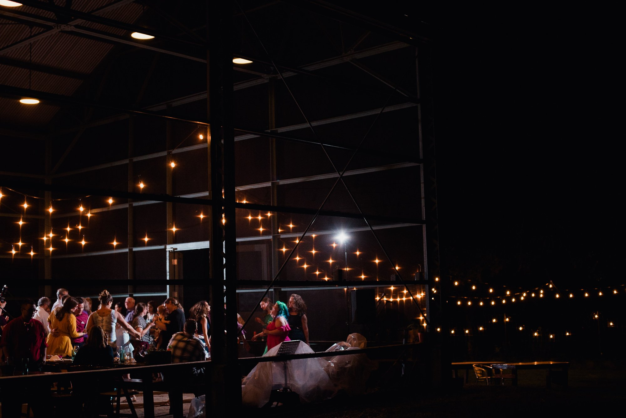 reception dancing under string lights at the plant at kyle in austin texas