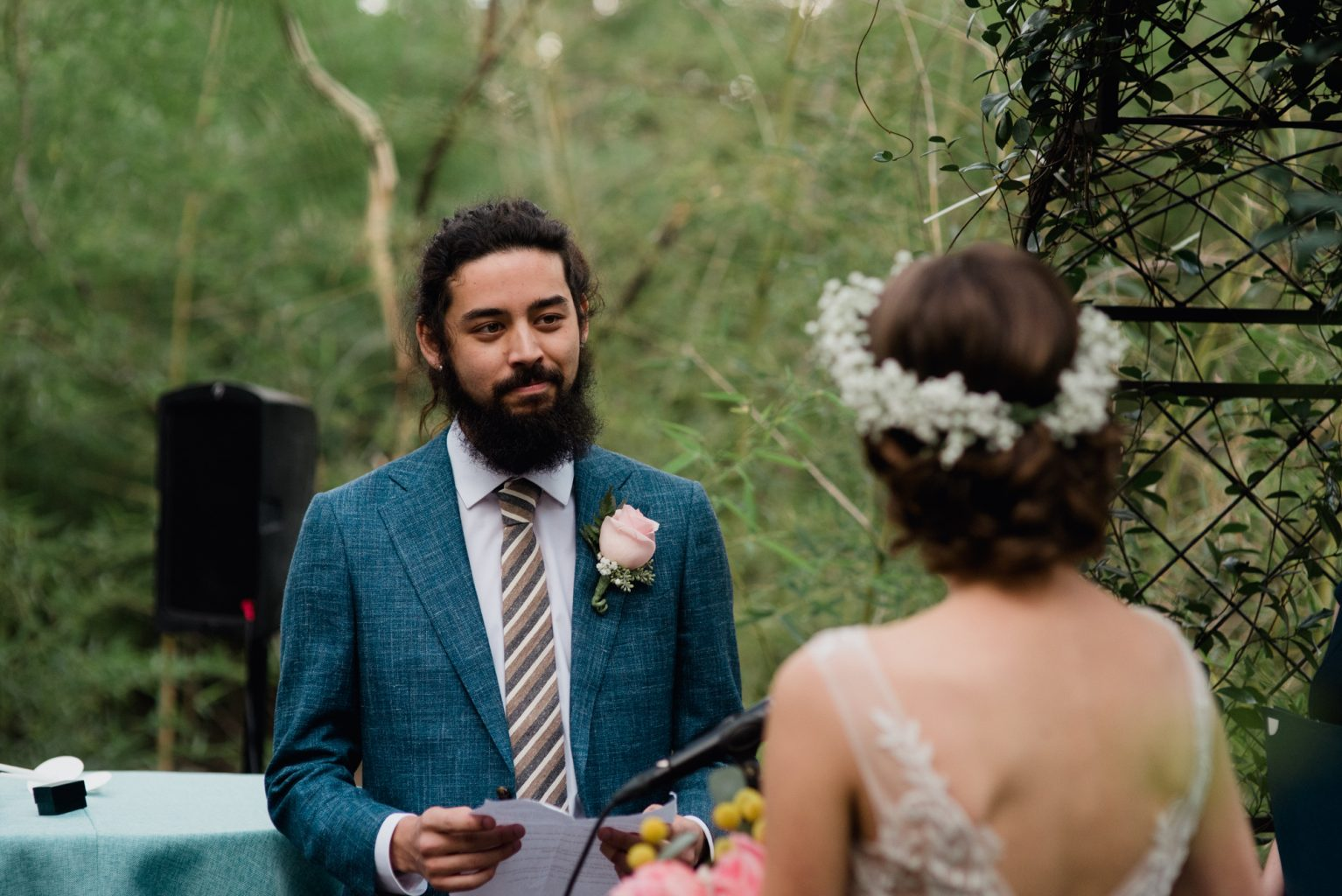 Our groom reads emotional vows during his backyard wedding in Austin Texas