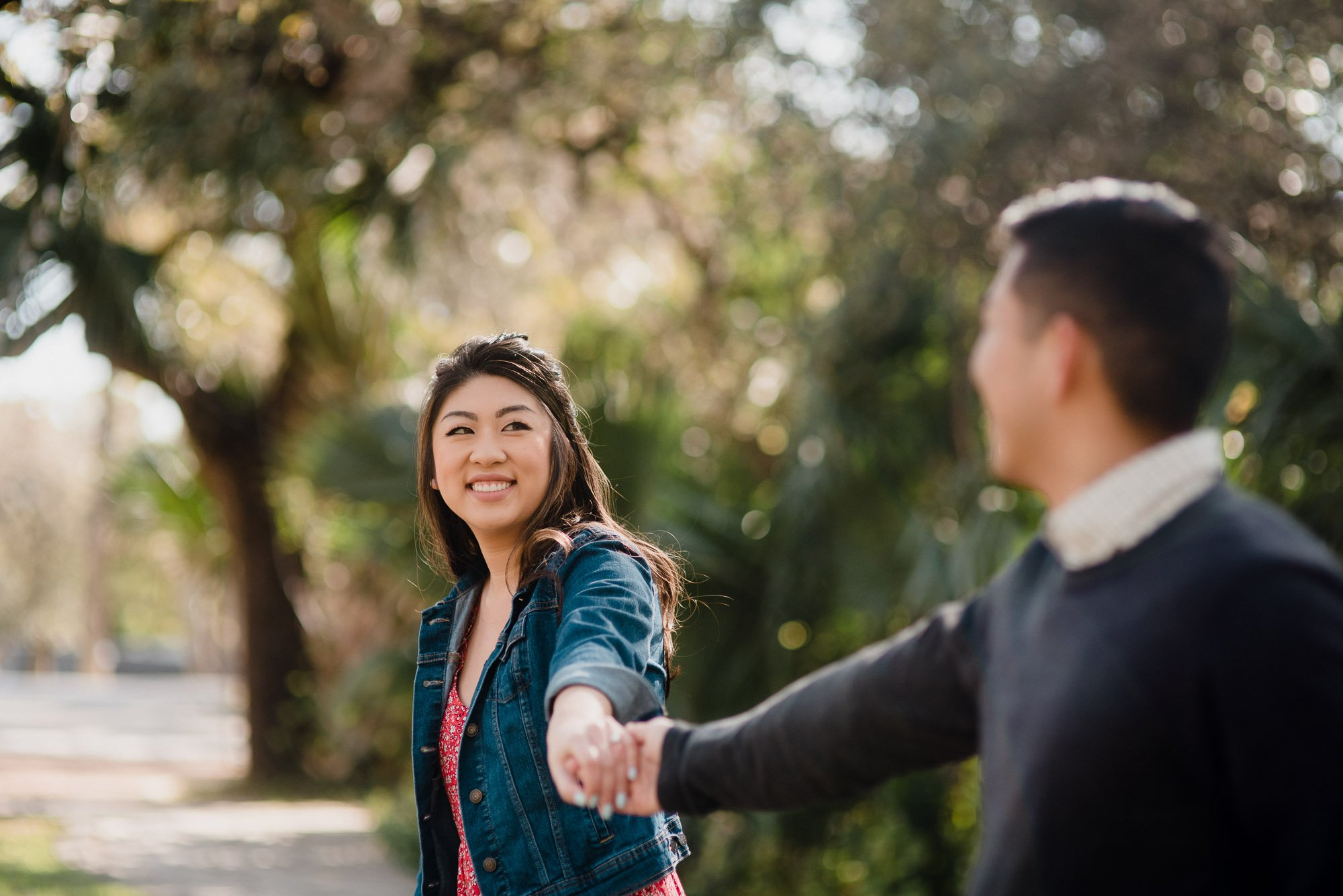 Austin engagement photos at Laguna Gloria, asian couple looks happy at their engagement session in austin, austin texas engagement photographer