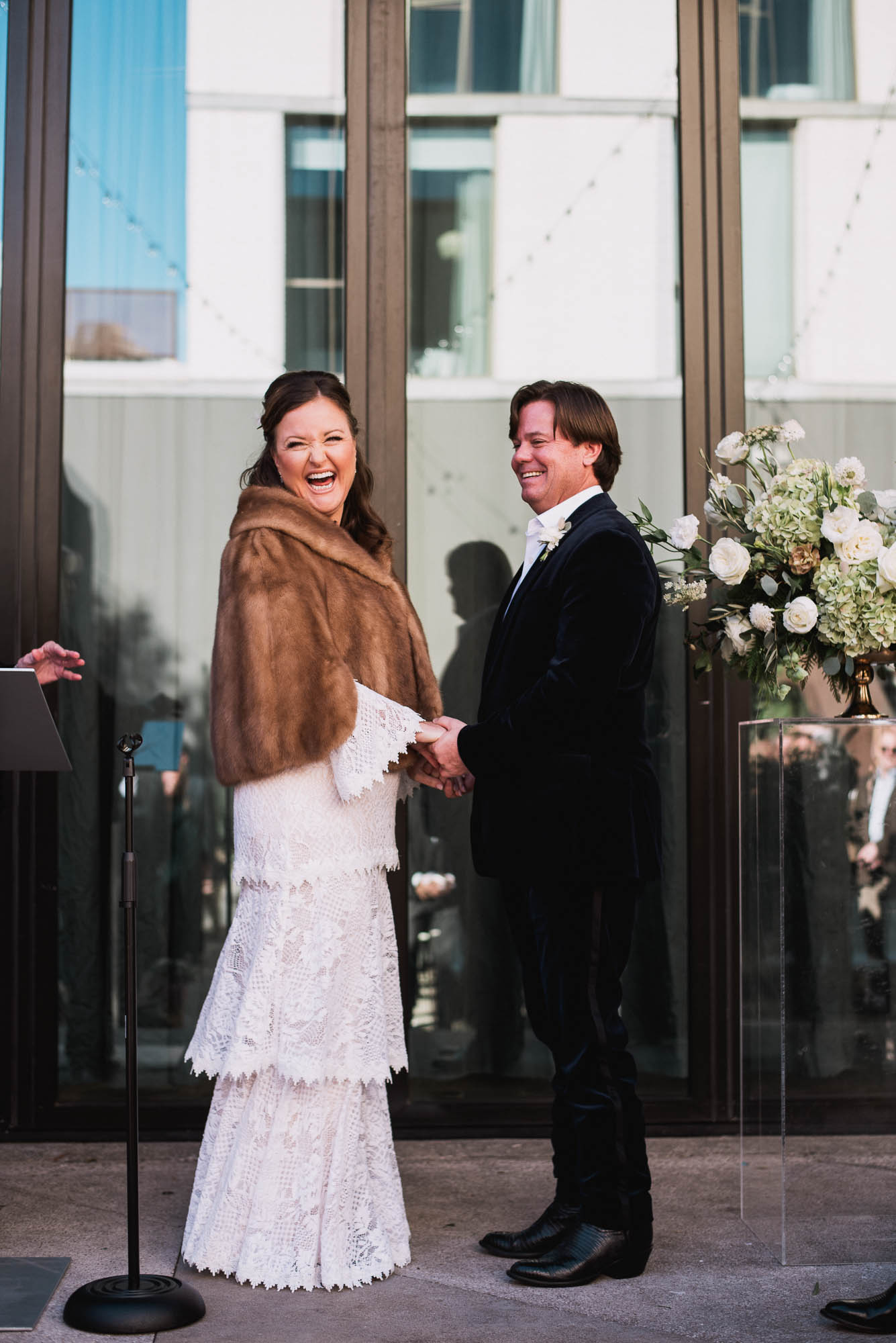 bride and groom laughing at their non-traditional winter wedding in austin, texas