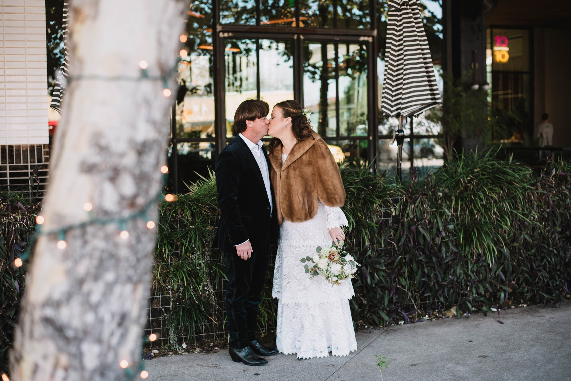 older couple kiss outside the south congress hotel in Austin texas, Austin texas modern wedding photographer