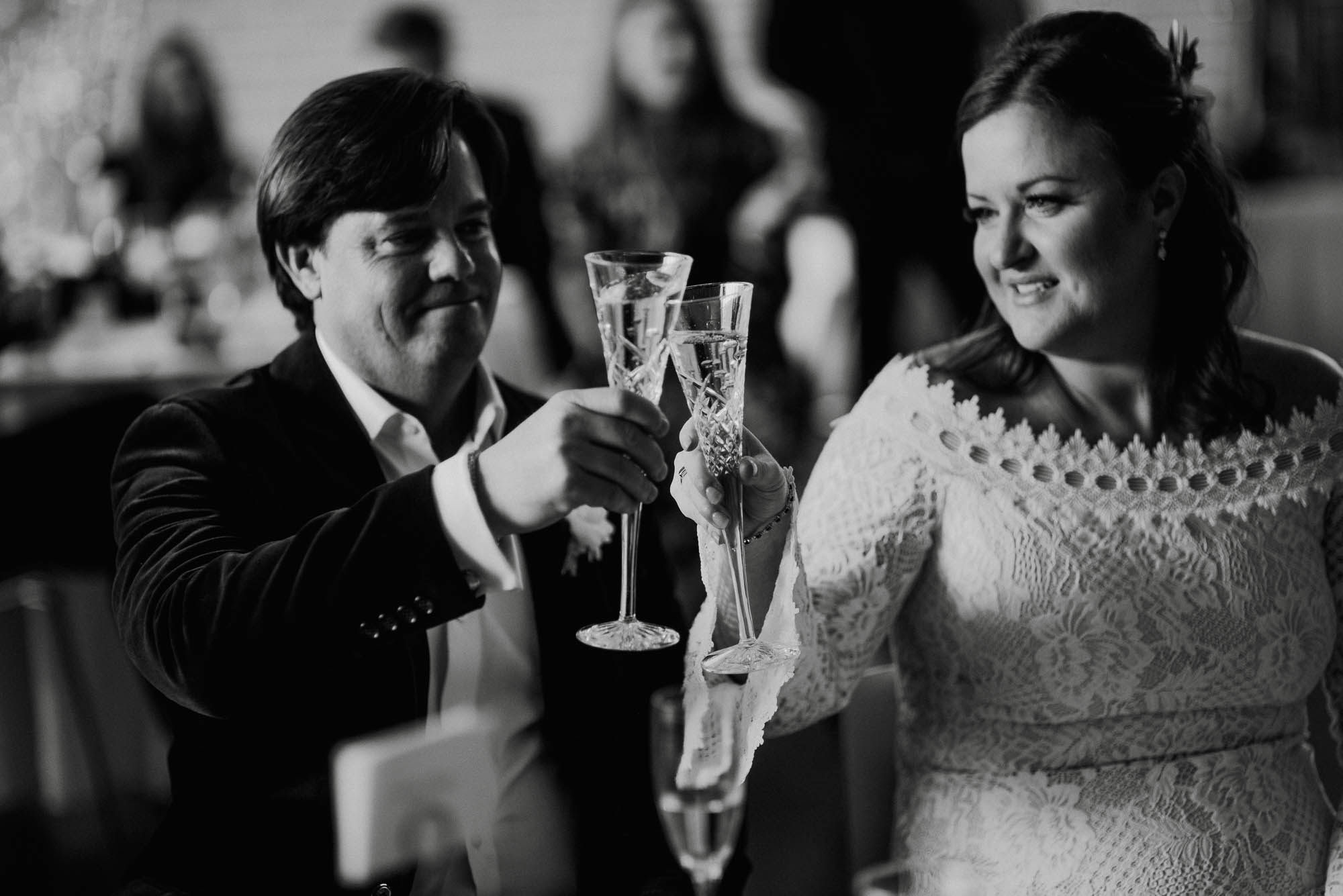black and white wedding photos, bride and groom toast with waterford crystal champagne flutes at a brunch wedding in austin texas, brunch wedding photography, south congress hotel wedding