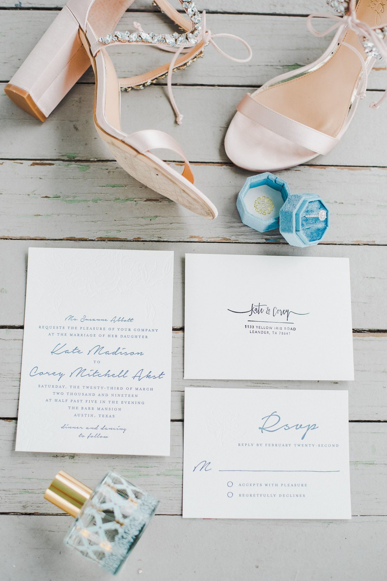 wedding details with pink shoes and simple invitation
