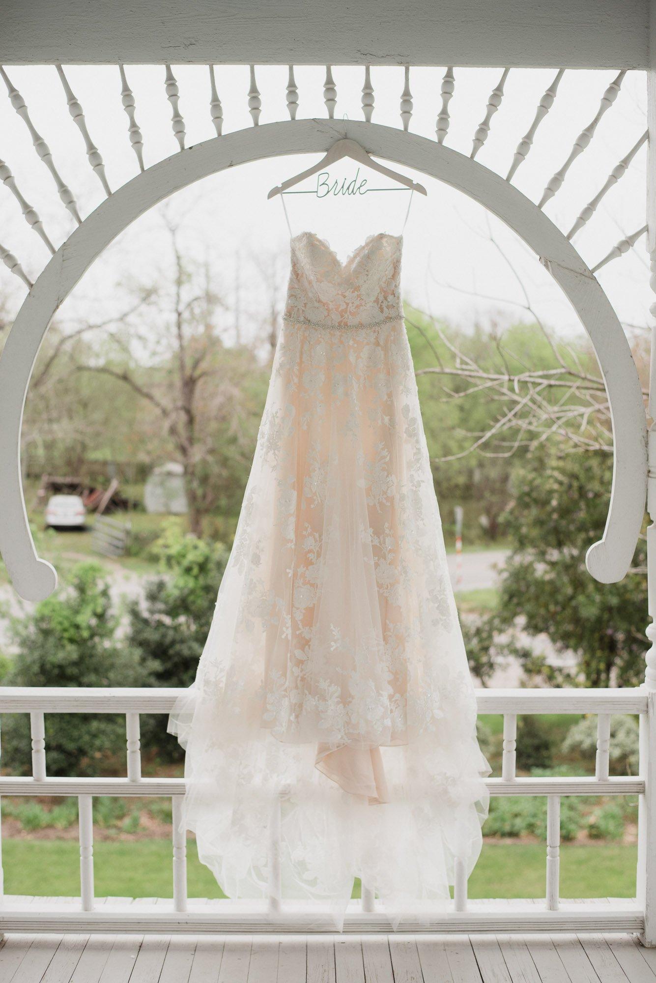 bride dress detail hanging at barr mansion