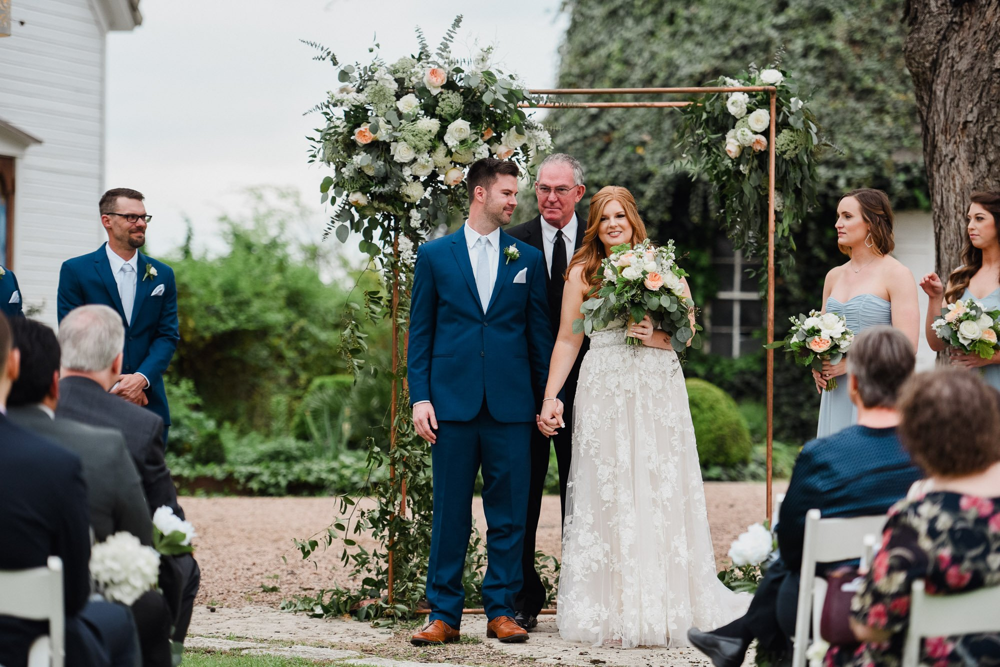bride and groom at their outdoor barr mansion wedding ceremony