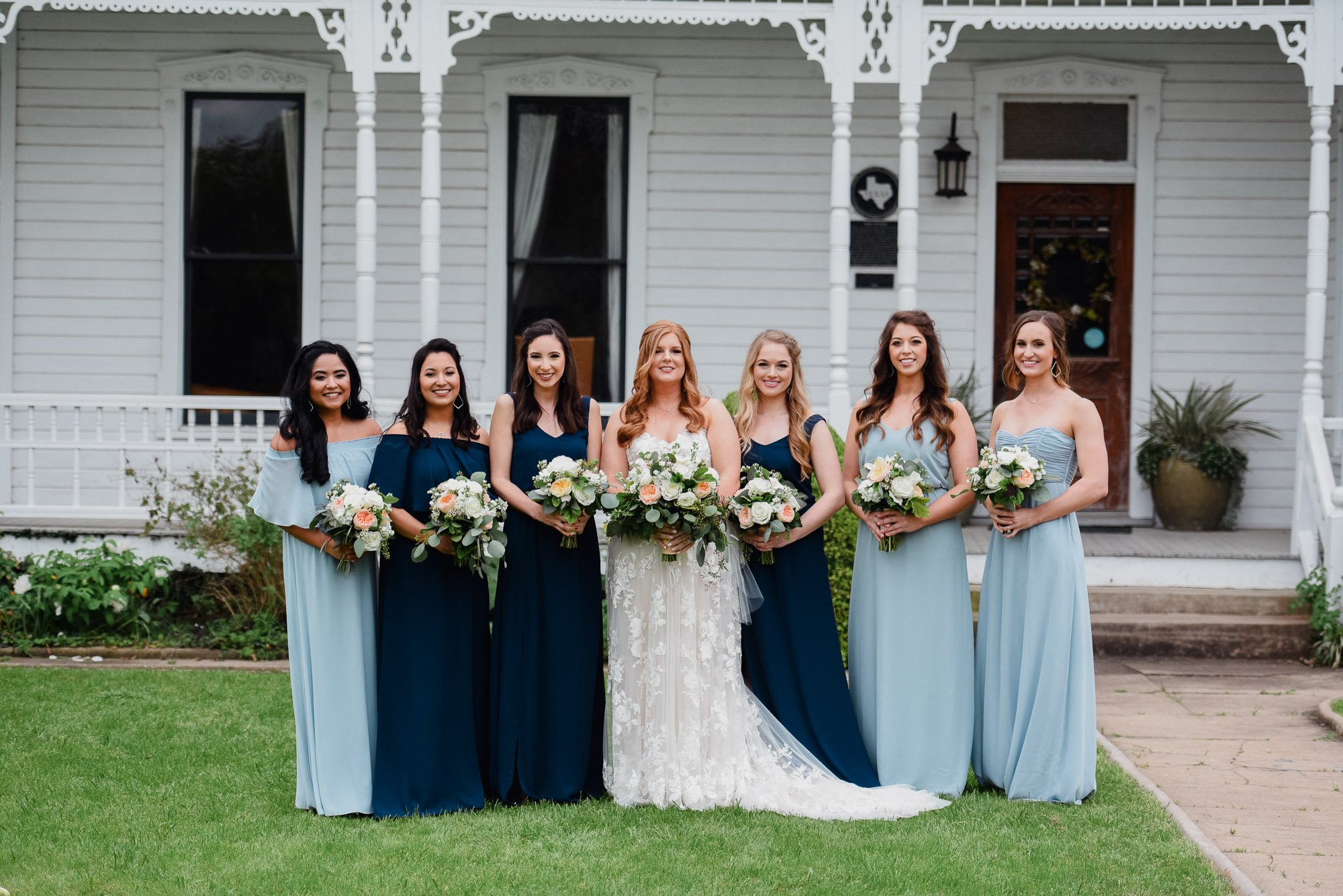 bridesmaids in various shades of blue