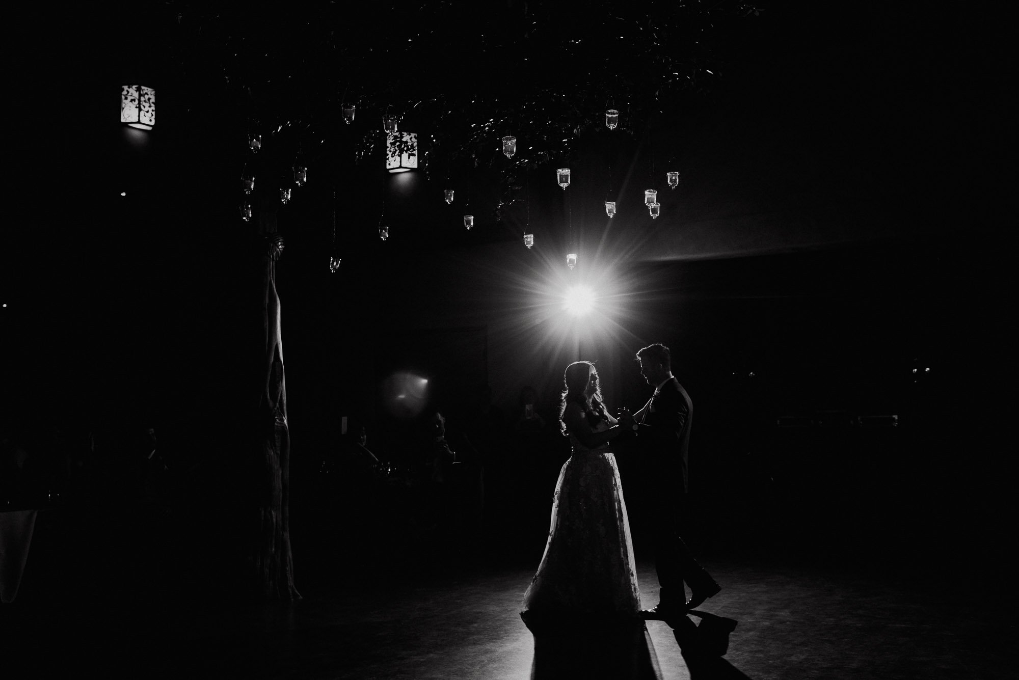 black and white night shot of a couple dancing at their wedding, austin wedding at the barr mansion, spring wedding at the barr mansion in austin, austin wedding photographer