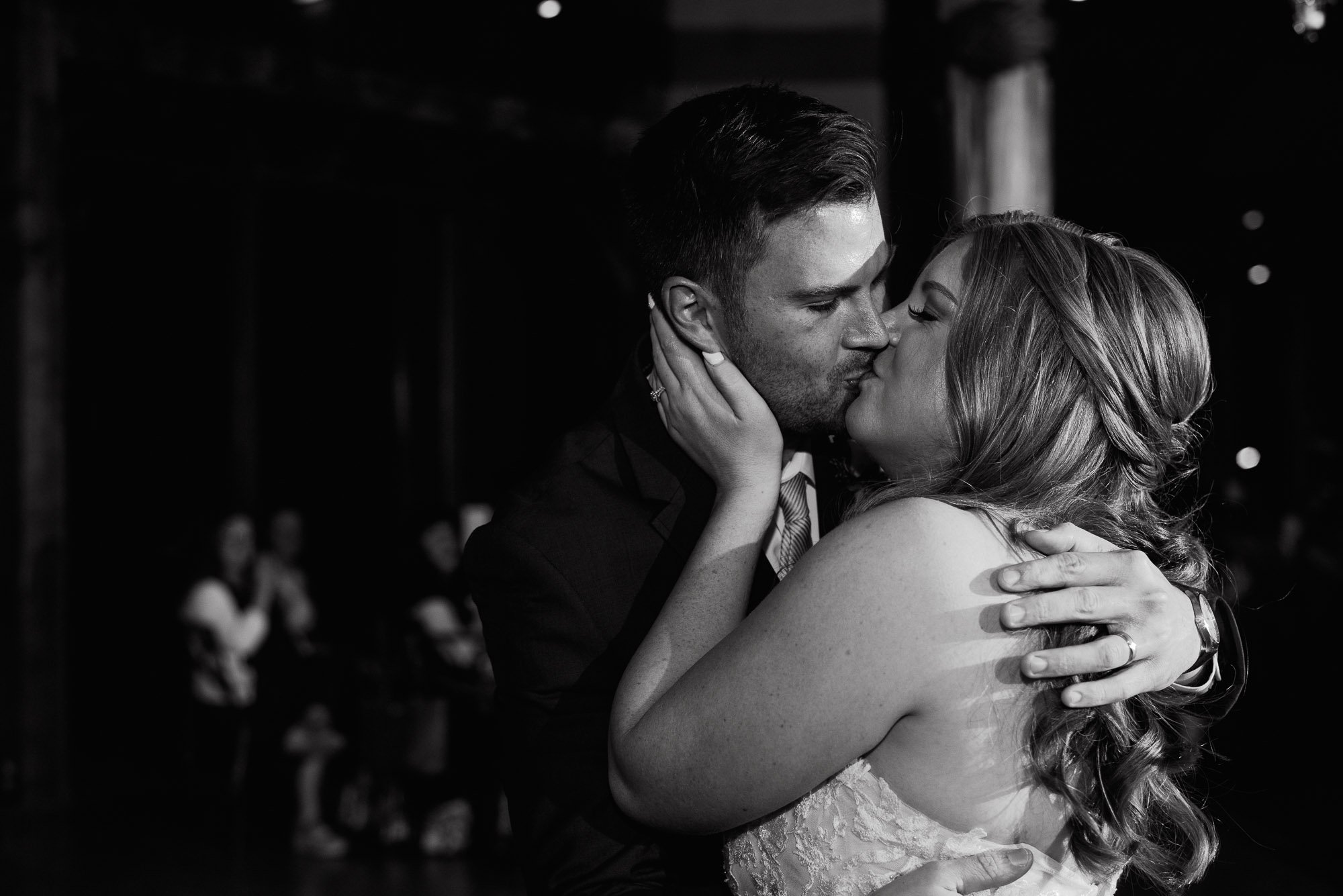 couple kisses after their first dance at the barr mansion in austin texas, photojournalistic wedding photographer, documentary wedding photography in austin, austin wedding photographer