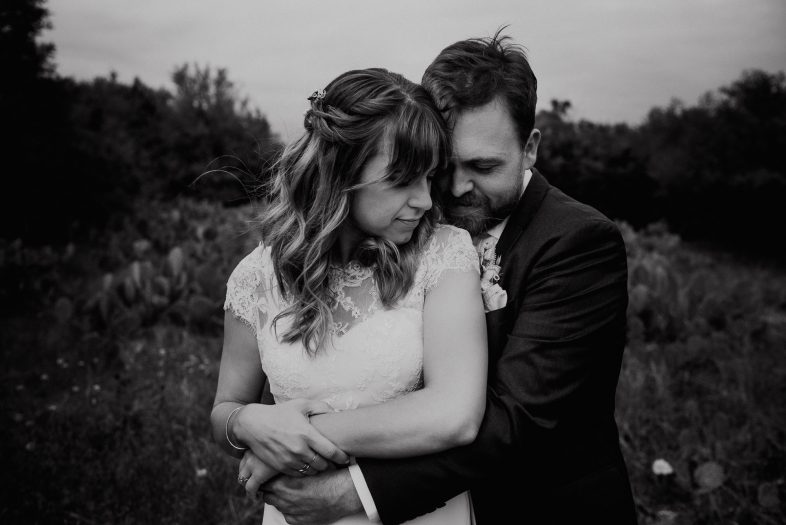 a couple snuggles up close for some bride and groom portraits