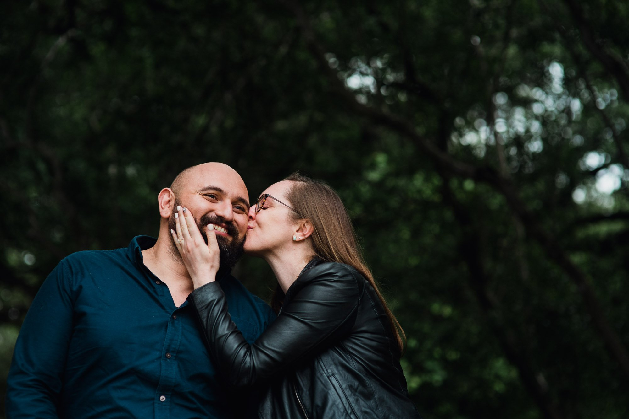 a kiss on the cheek for her fiance at the botanical gardens during an engagement session, austin proposal photographer, portland engagement session, pdx photographer, portland engagement photographer