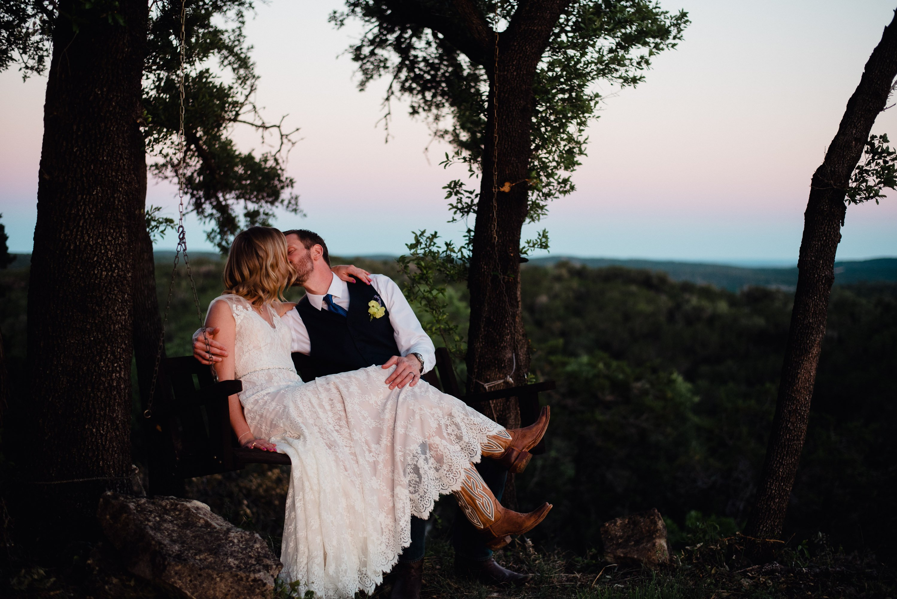 san antonio area wedding photographers, blue hour portraits, bride wearing cowboy boots at a Texas elopement