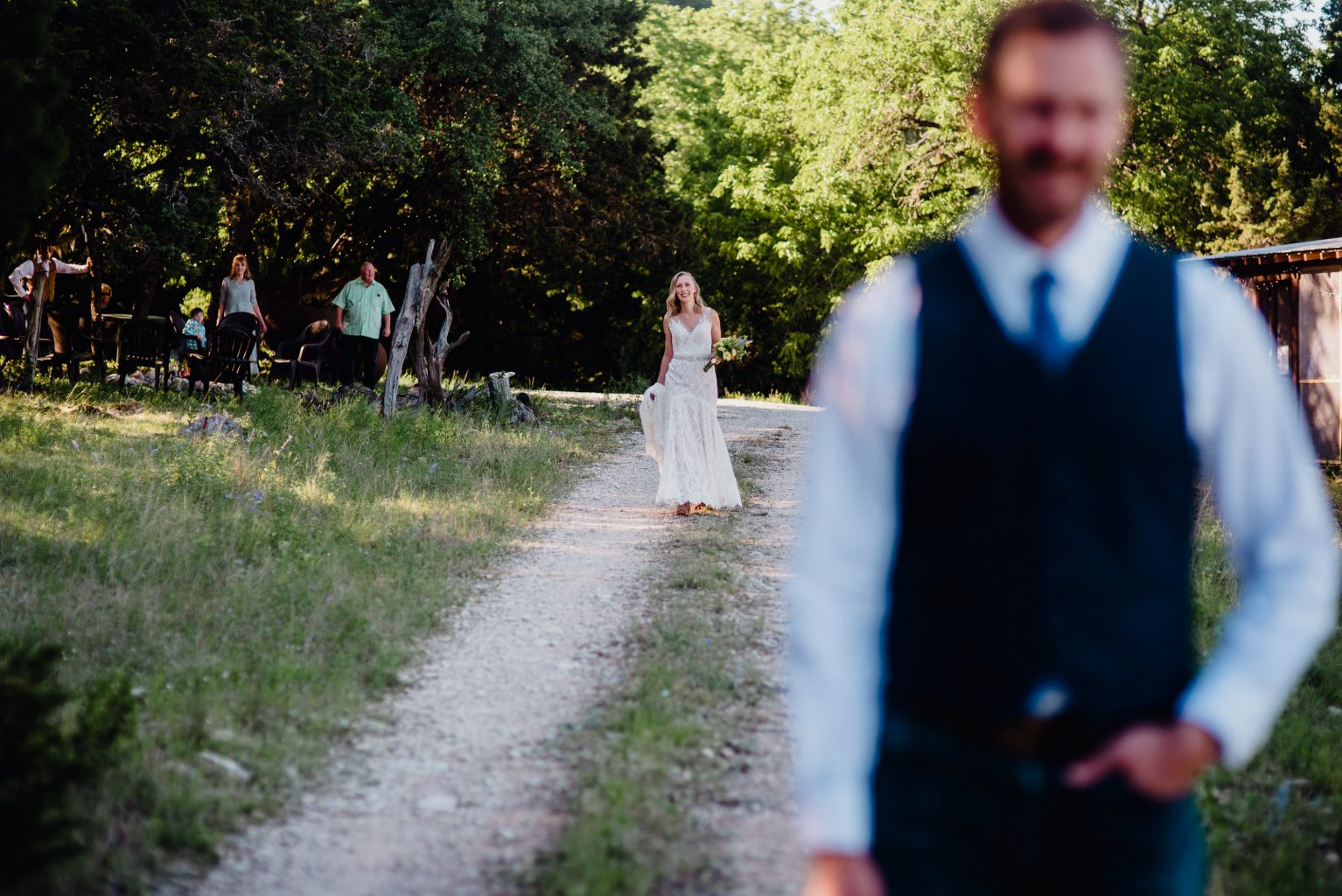 first look outside the family cabin at a utopia texas wedding