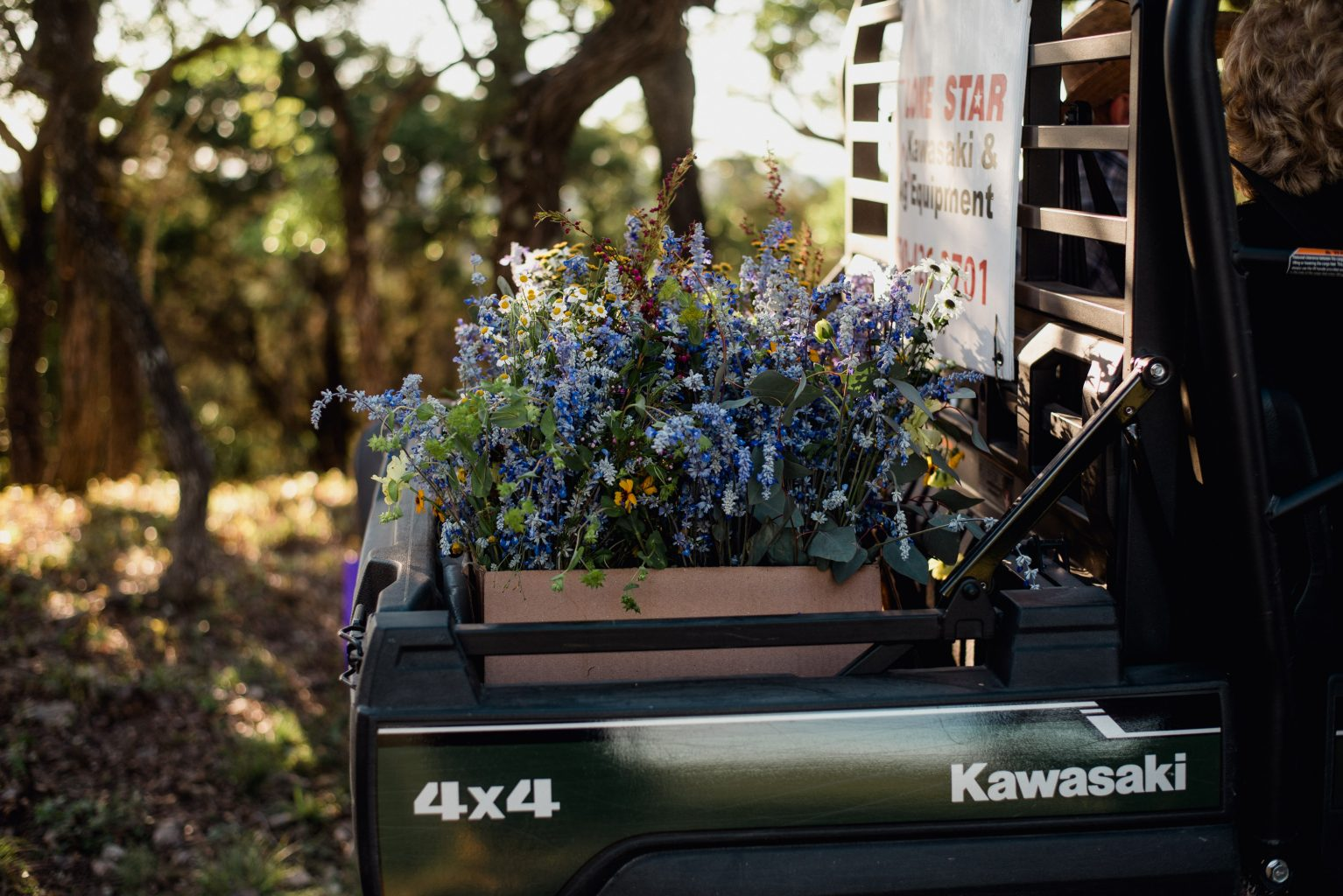 wildflower bouquets on the back of an ATV