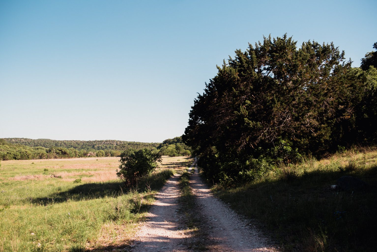 view down a dirt road on the way to a wedding in Utopia Texas
