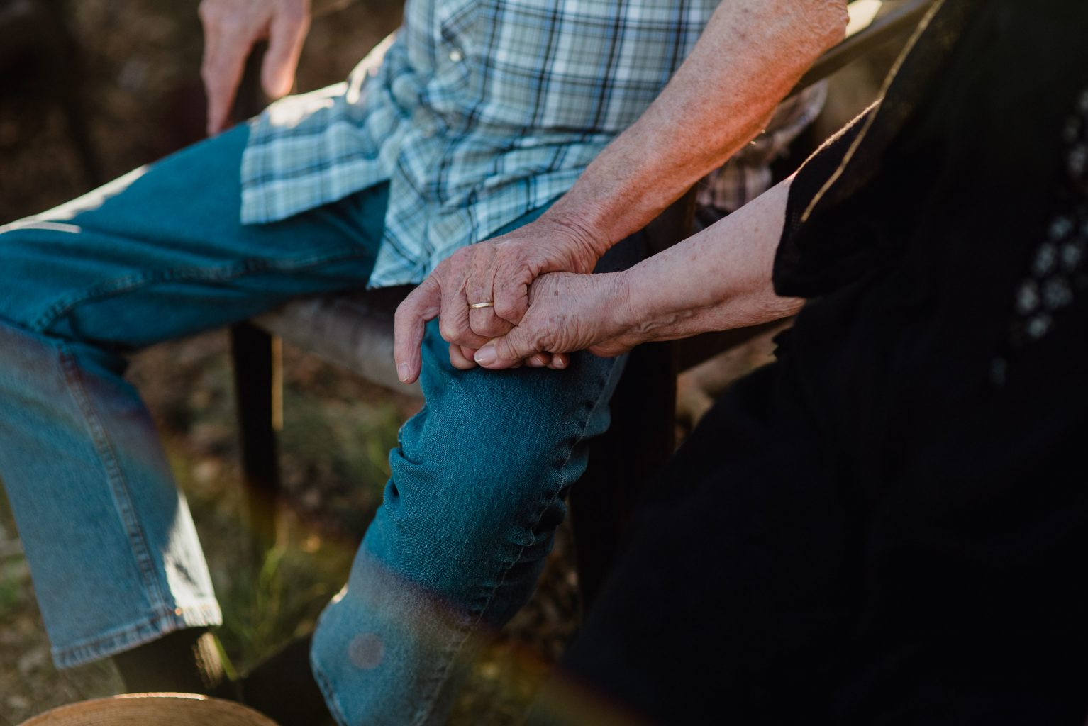 grandparents holding hands at a country ranch wedding in utopia texas