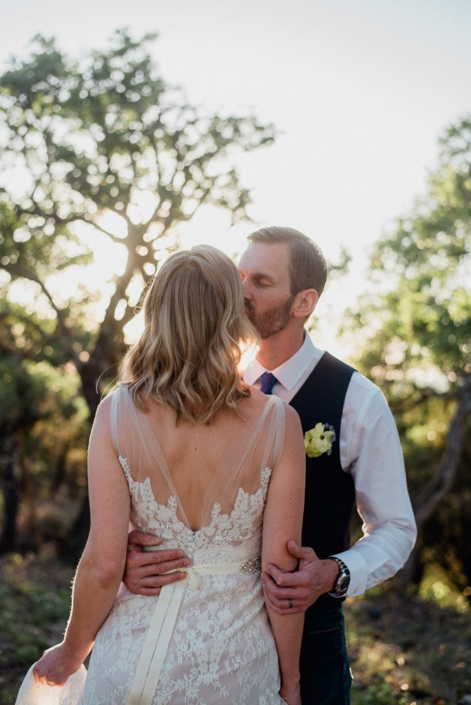 boerne intimate wedding photos, bhldn wedding dress and a kiss on the cheek from her husband
