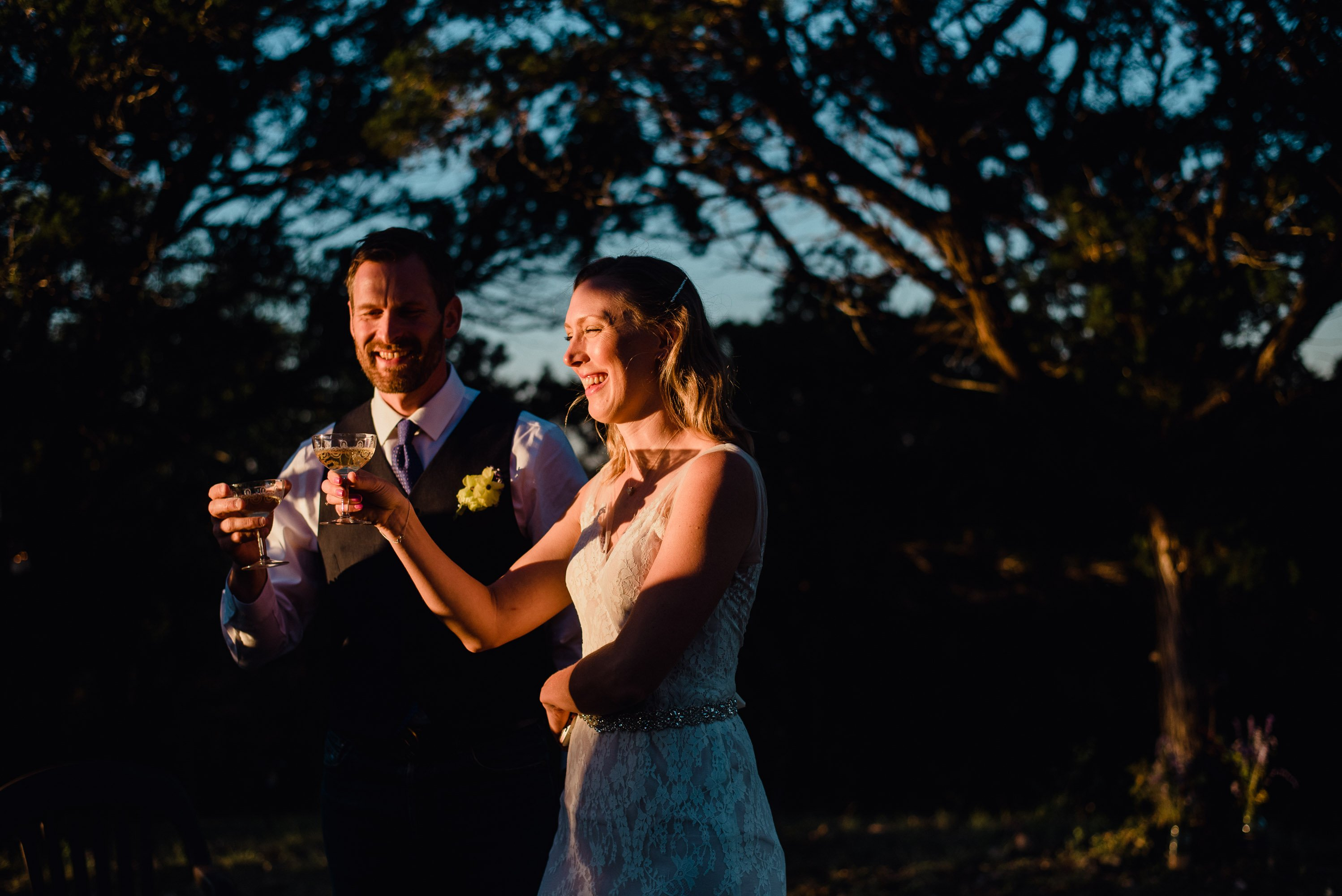 champagne toast into the sun at a mountaintop elopement in Utopia Texas