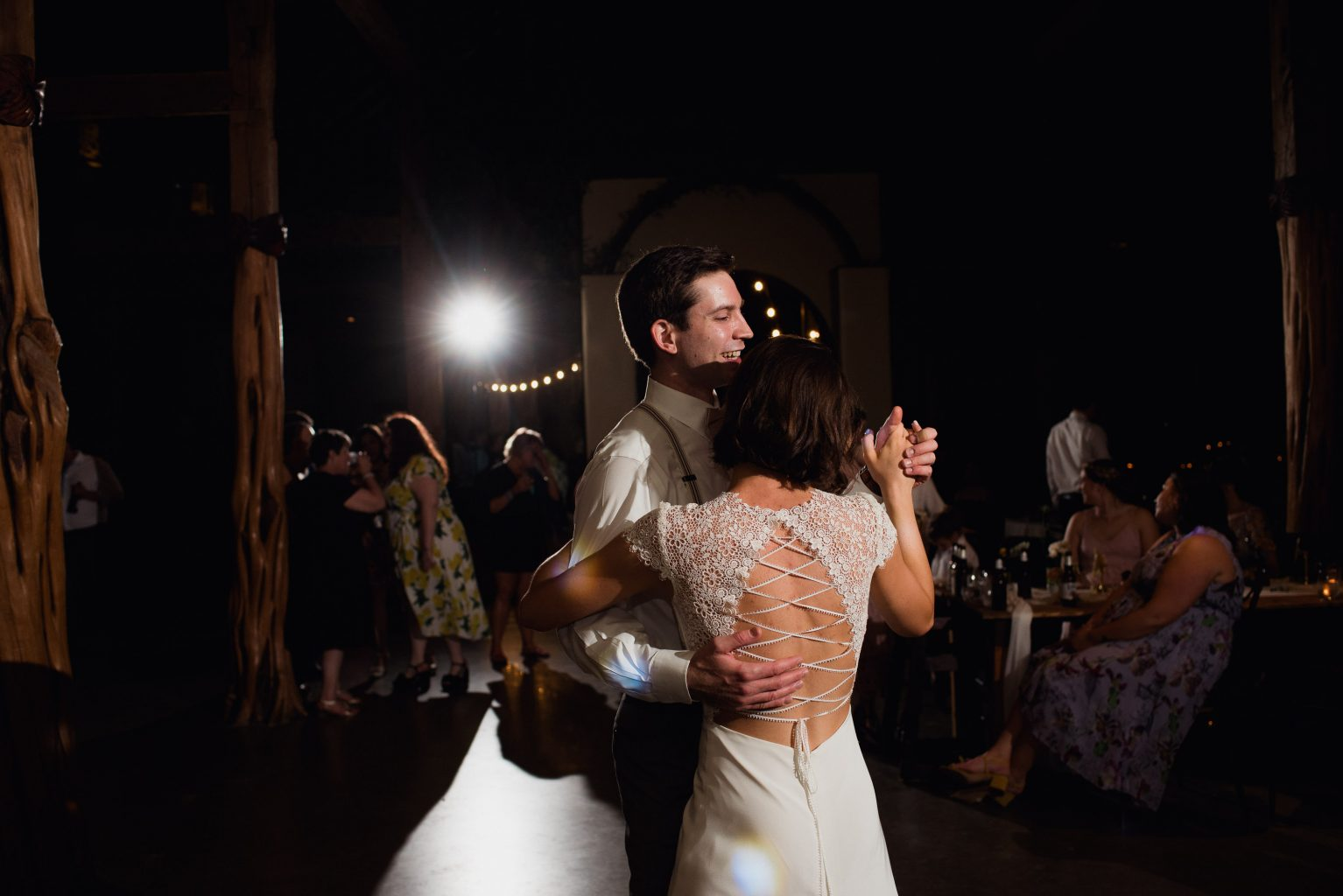 happy married couple dances at their reception in austin