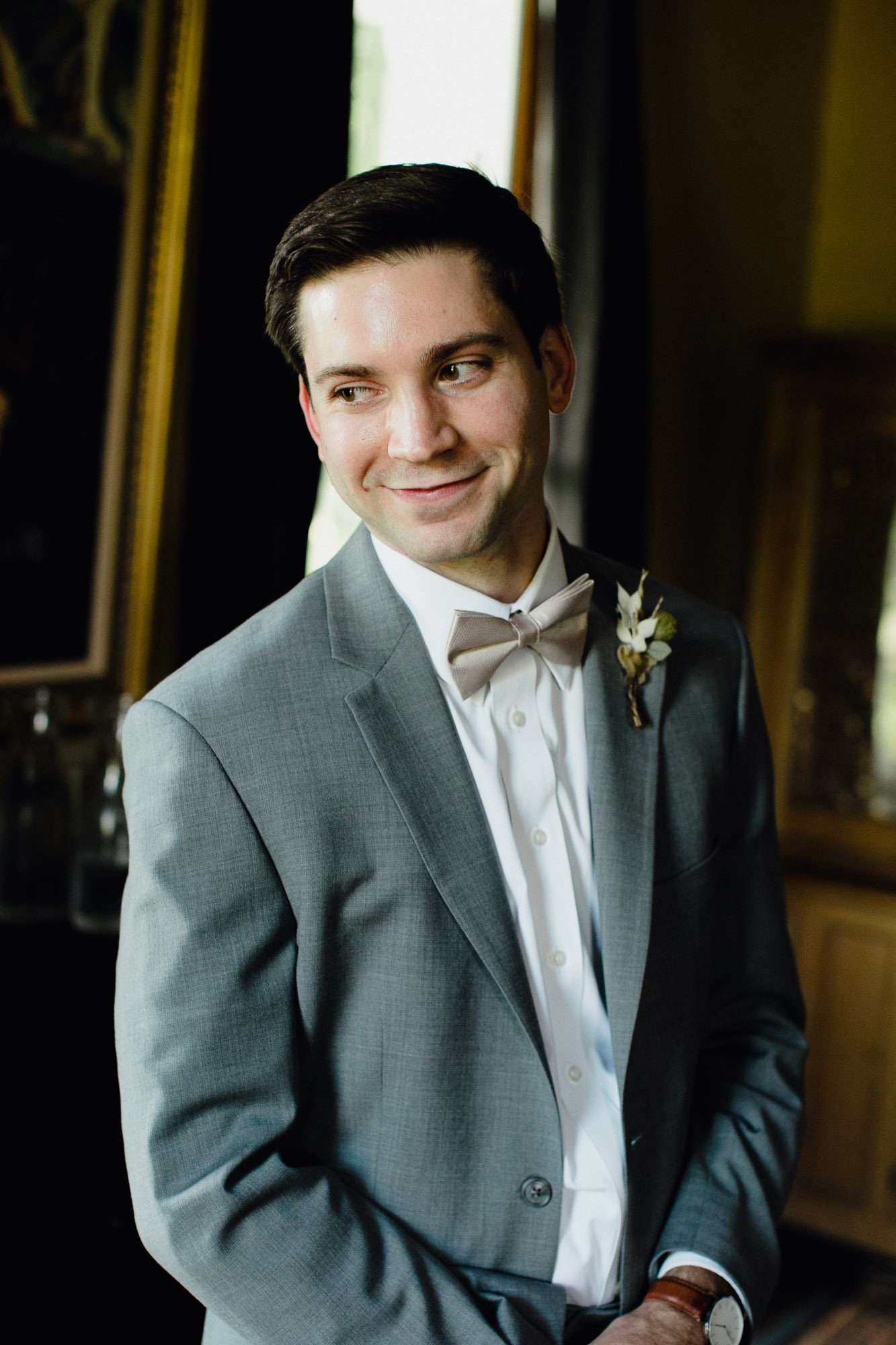 headshot of a groom looking handsome at his Austin Texas wedding