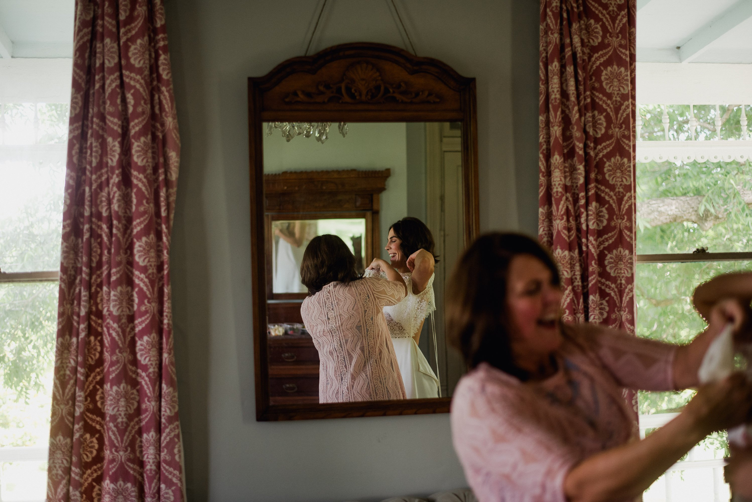 reflection of bride getting ready for her spring wedding at the Barr mansion