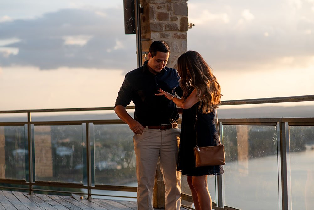 surprise family arrives during an austin proposal at the oasis