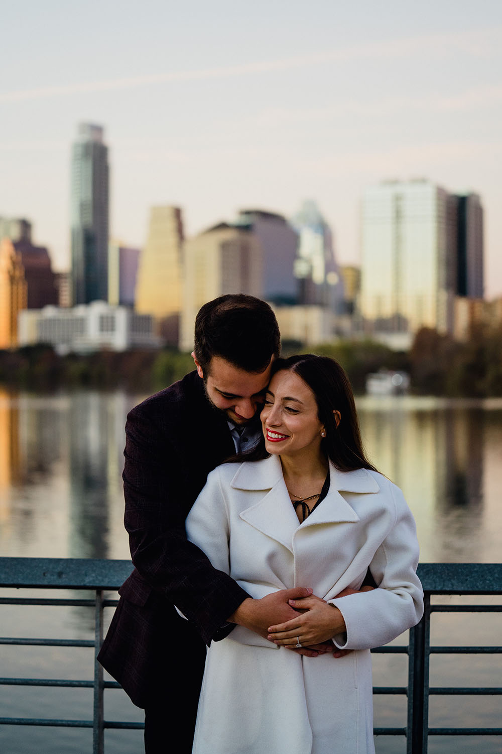 colorful, romantic and natural looking engagement photos with the austin skyline in the background