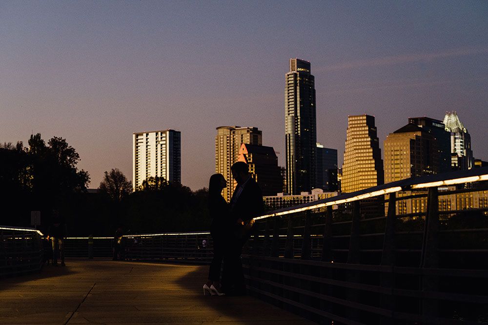 austin proposal photographs at night, blue hour silhouette of a couple in front of the austin skyline, sony a7iii