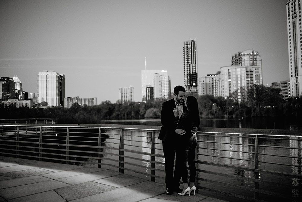 black and white couples photos at the town lake boardwalk
