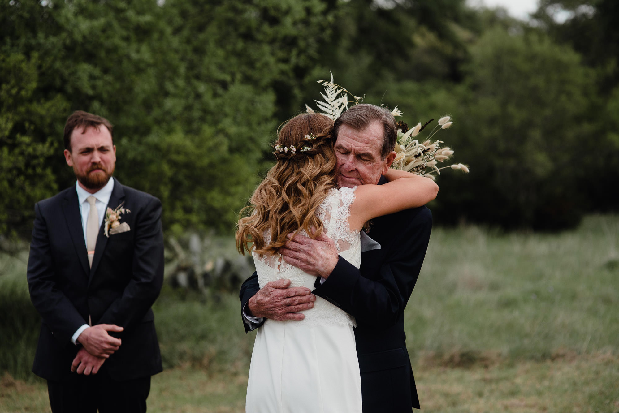 Kaci hugs her dad at the end of the aisle at her Plant at Kyle wedding