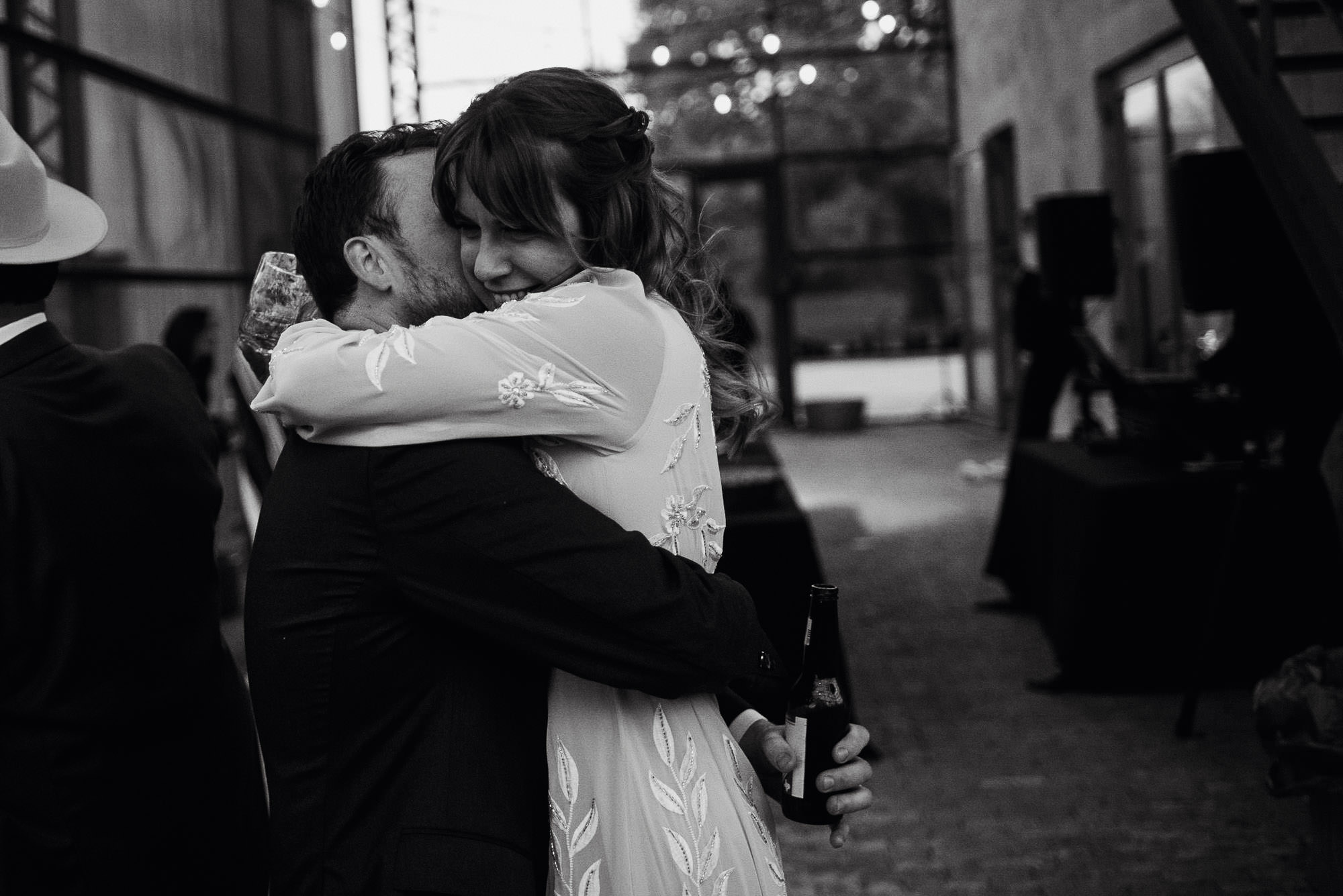 black and white snapshot of the bride and groom hugging at their west texas inspired wedding